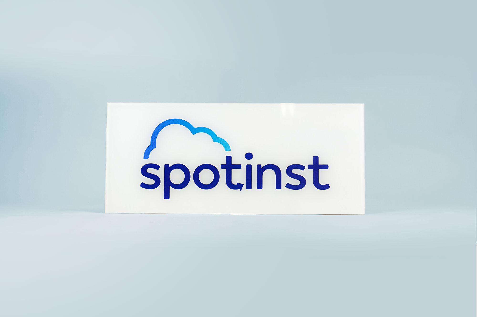 Glossy, glass-like back printed panel sign for the office of Spotinst, a San Francisco company that creates workload software.