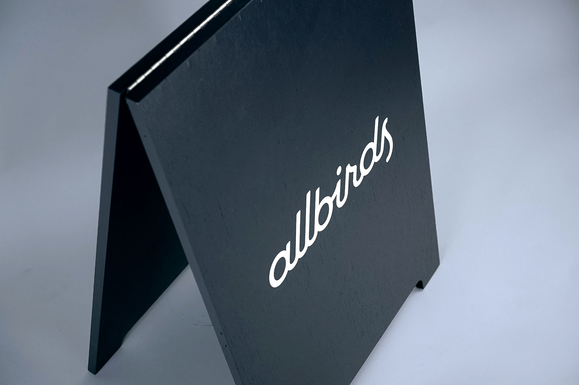 Minimalist black and white A-frame for Allbirds, a San Francisco-based direct-to-consumer startup aimed at designing environmentally friendly footwear.