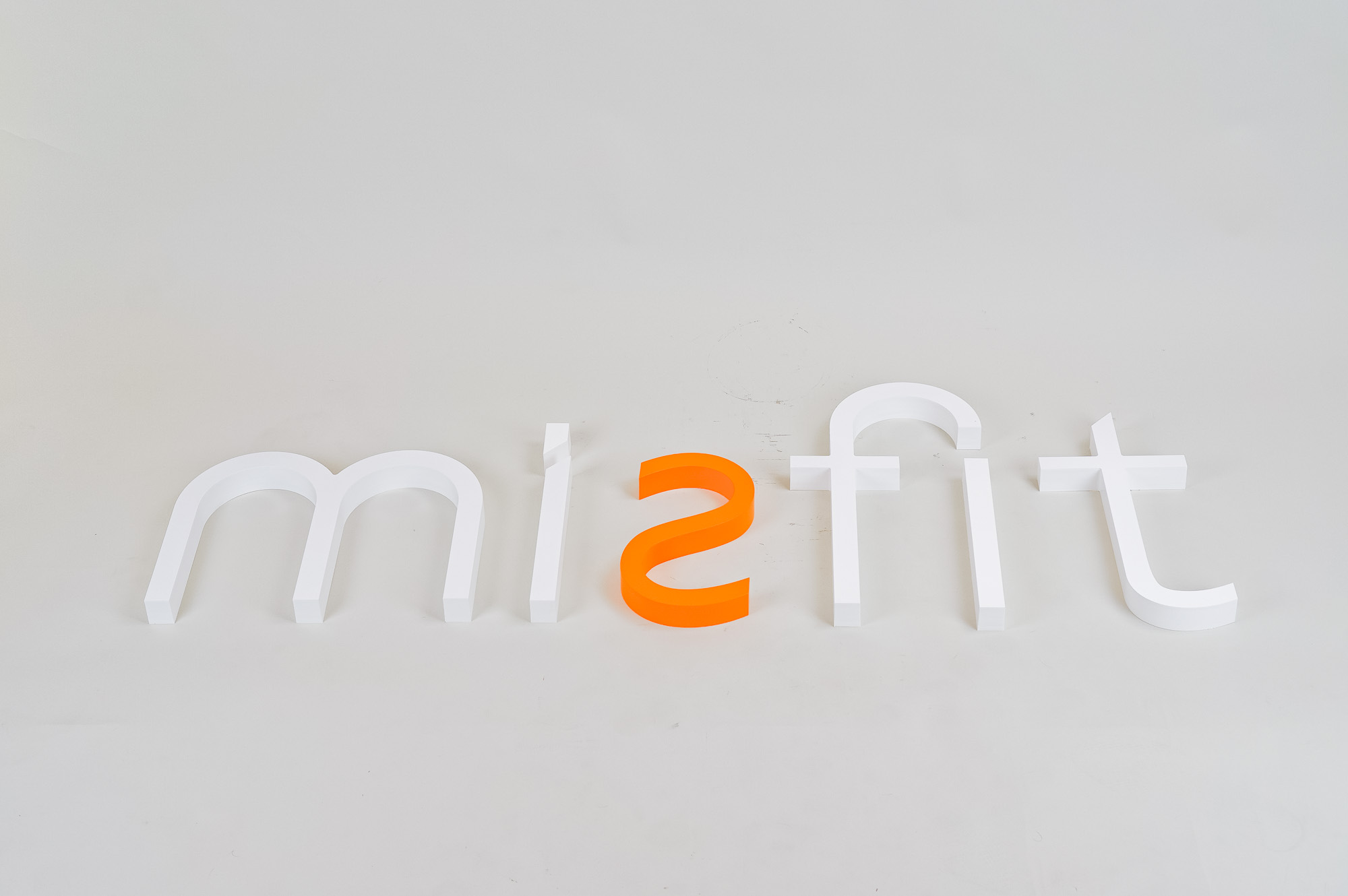 White and orange letter sign for Misfit, a strategic marketing agency.