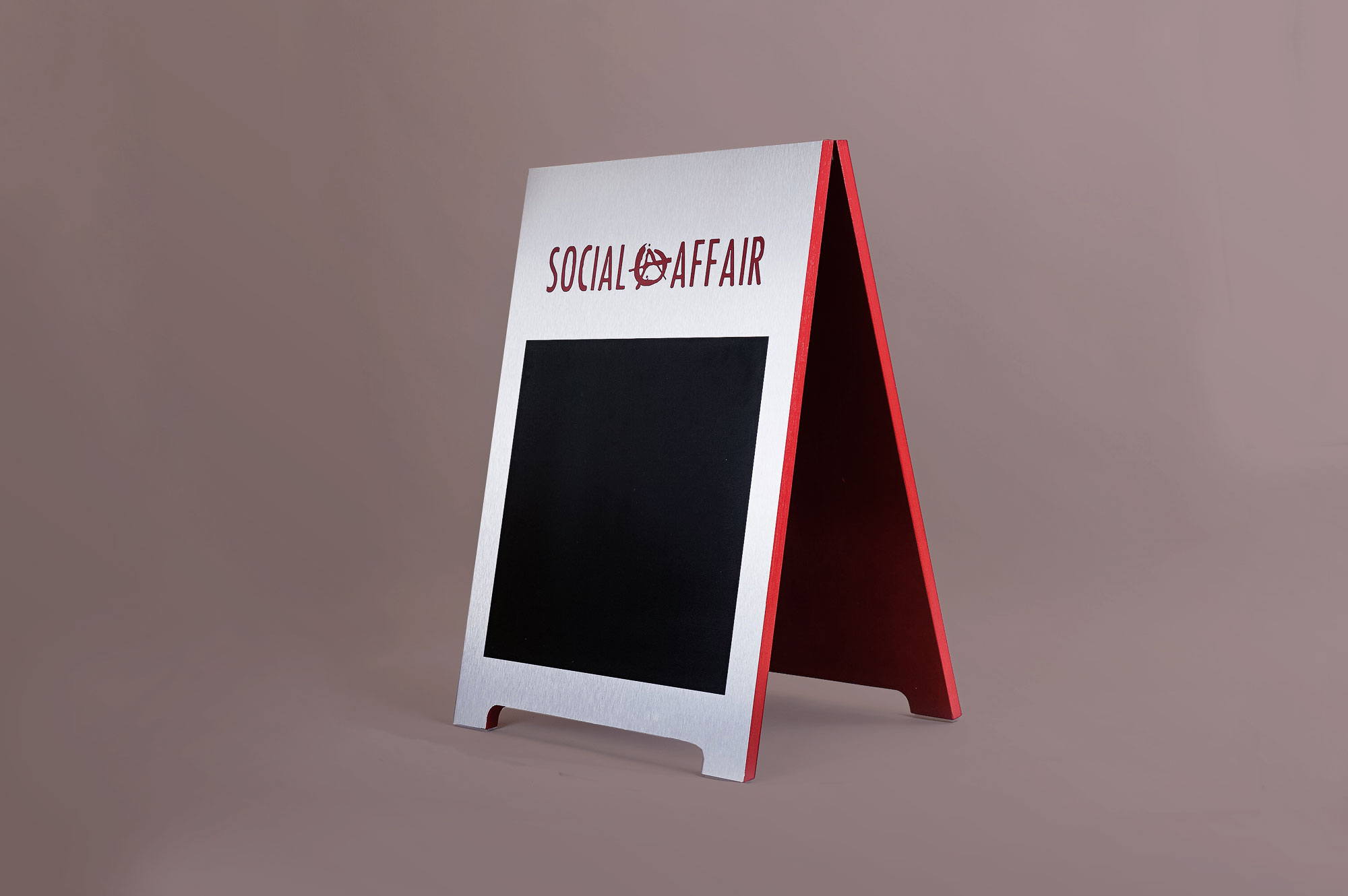 Metal and red A-frame sign for Social Affair, a restaurant serving artisanal food, wine and chai in a casual and modern lounge