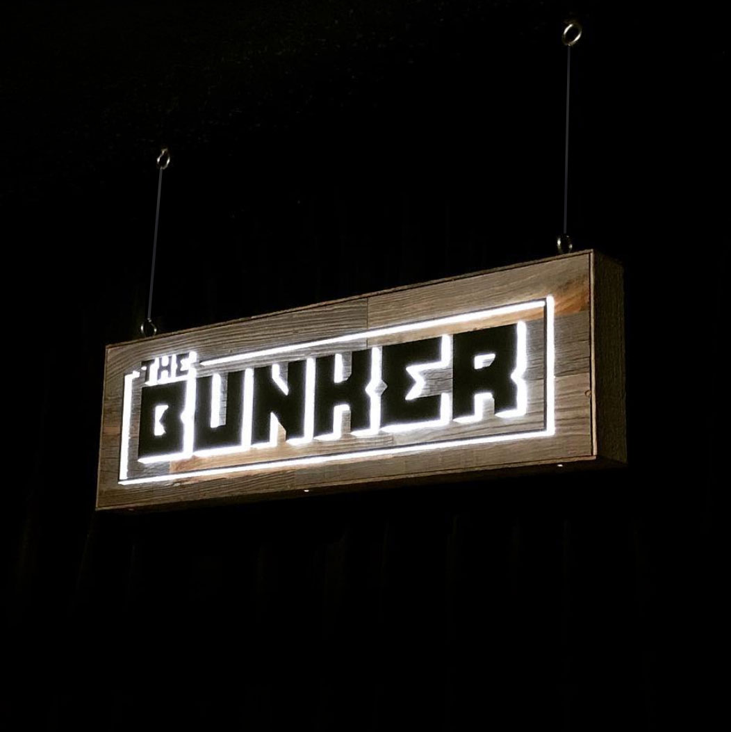 Illuminated, reclaimed wood sign for The Bunker, a comedy club in Burbank, CA.
