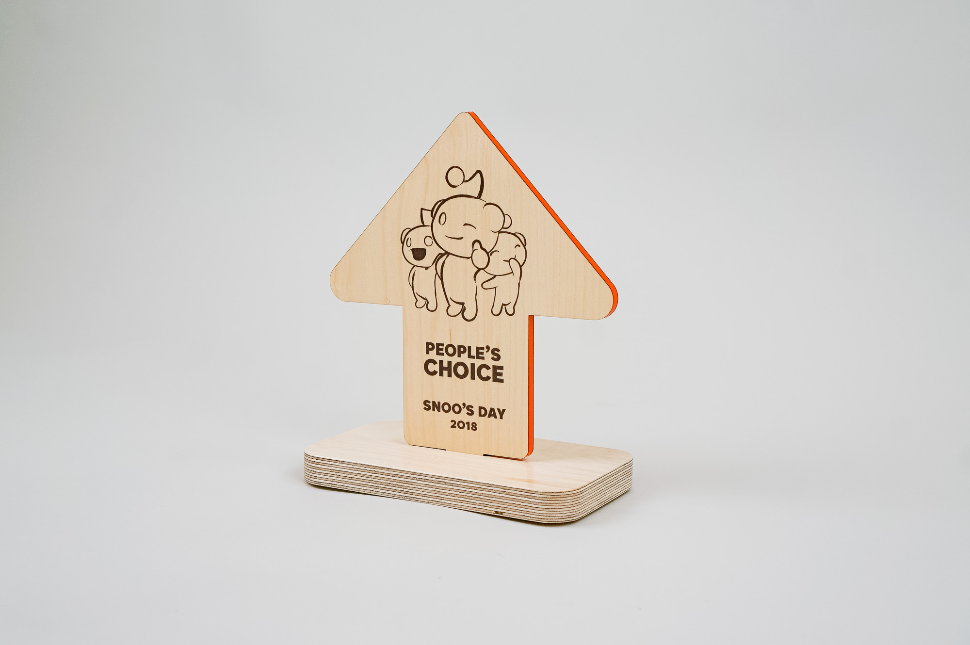 Custom wood arrow shaped 2018 team awards for Reddit, an American social news aggregation, web content rating, and discussion website.