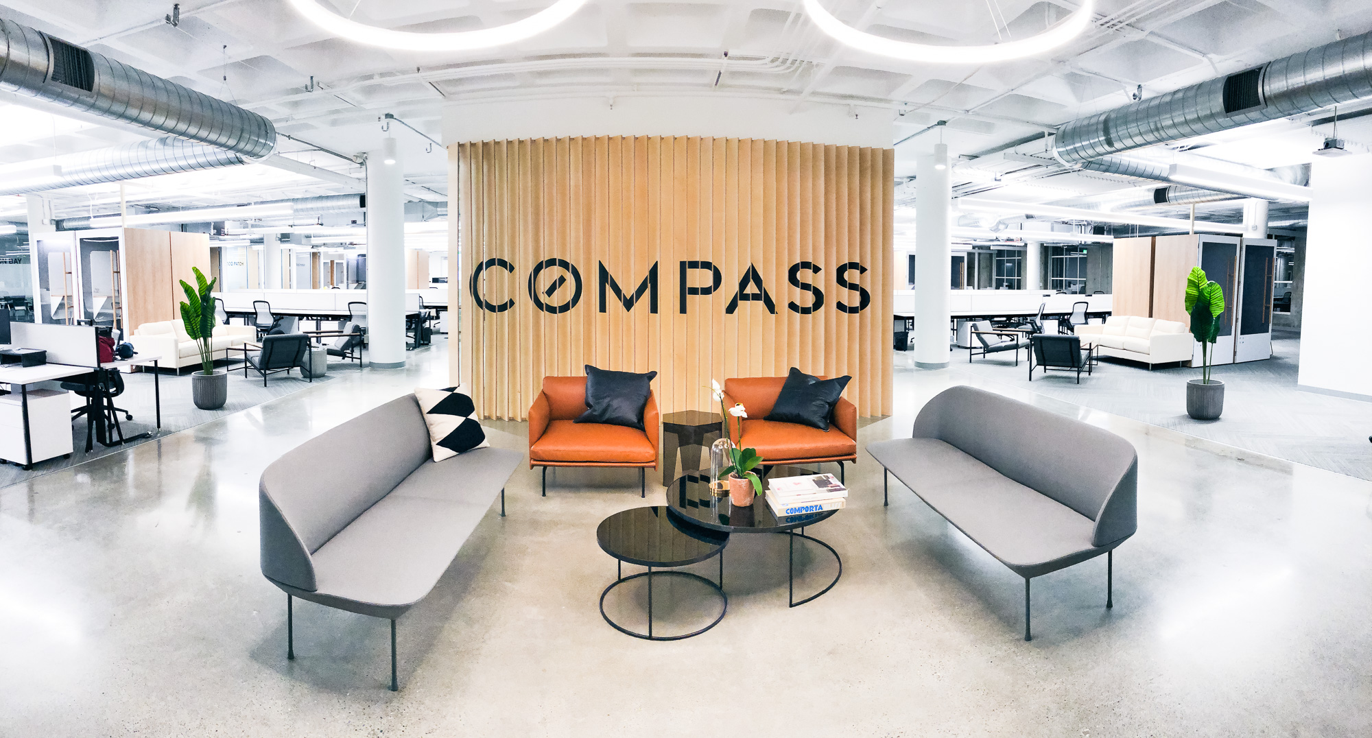 Optical-illusion, multi panel wood sign / privacy screen at the San Francisco office of Compass, a modern real estate platform.Optical-illusion, multi panel wood sign / privacy screen at the San Francisco office of Compass, a modern real estate platform.