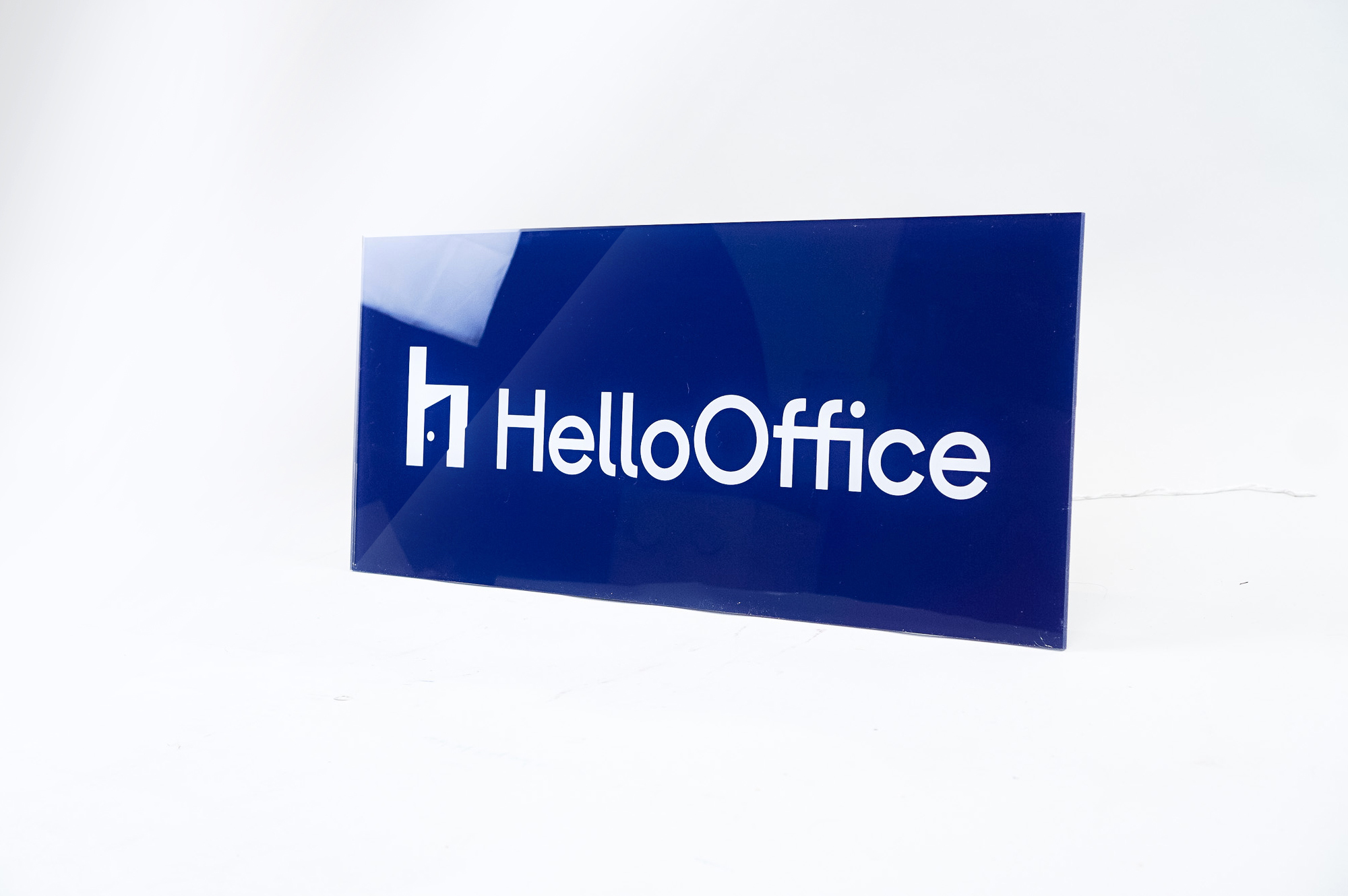 Glossy navy blue sign with white artwork for HelloOffice, a San Francisco based commercial brokerage built by startup founders, for startup founders.