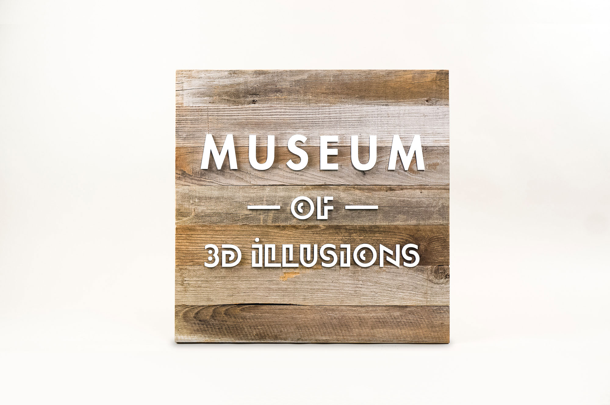 Reclaimed wood blade sign with white artwork for Museum of 3D Illusions in San Francisco.