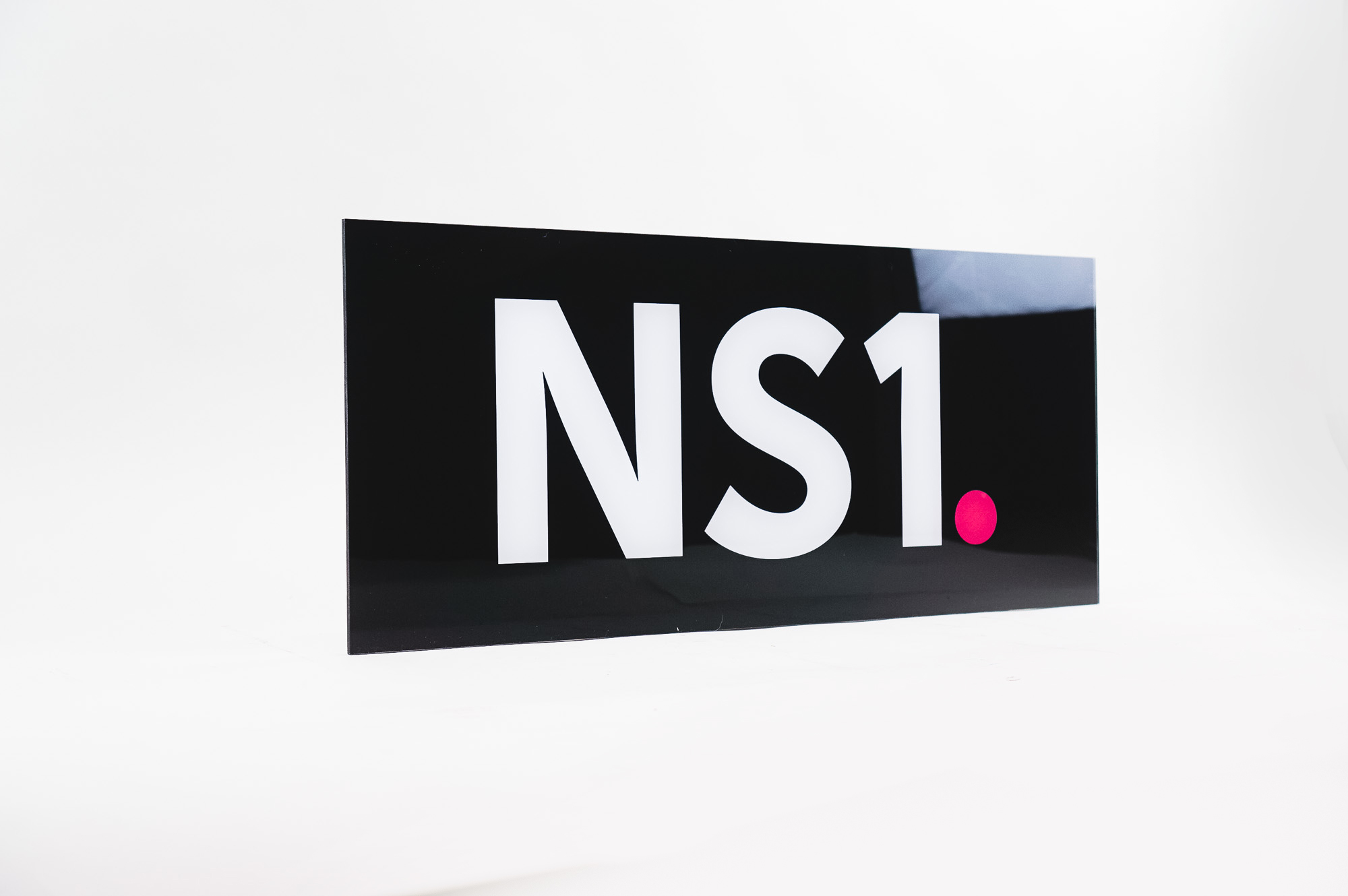 Glossy black, back-painted sign for NS1, a San Francisco based company that manages DNS and traffic technologies.