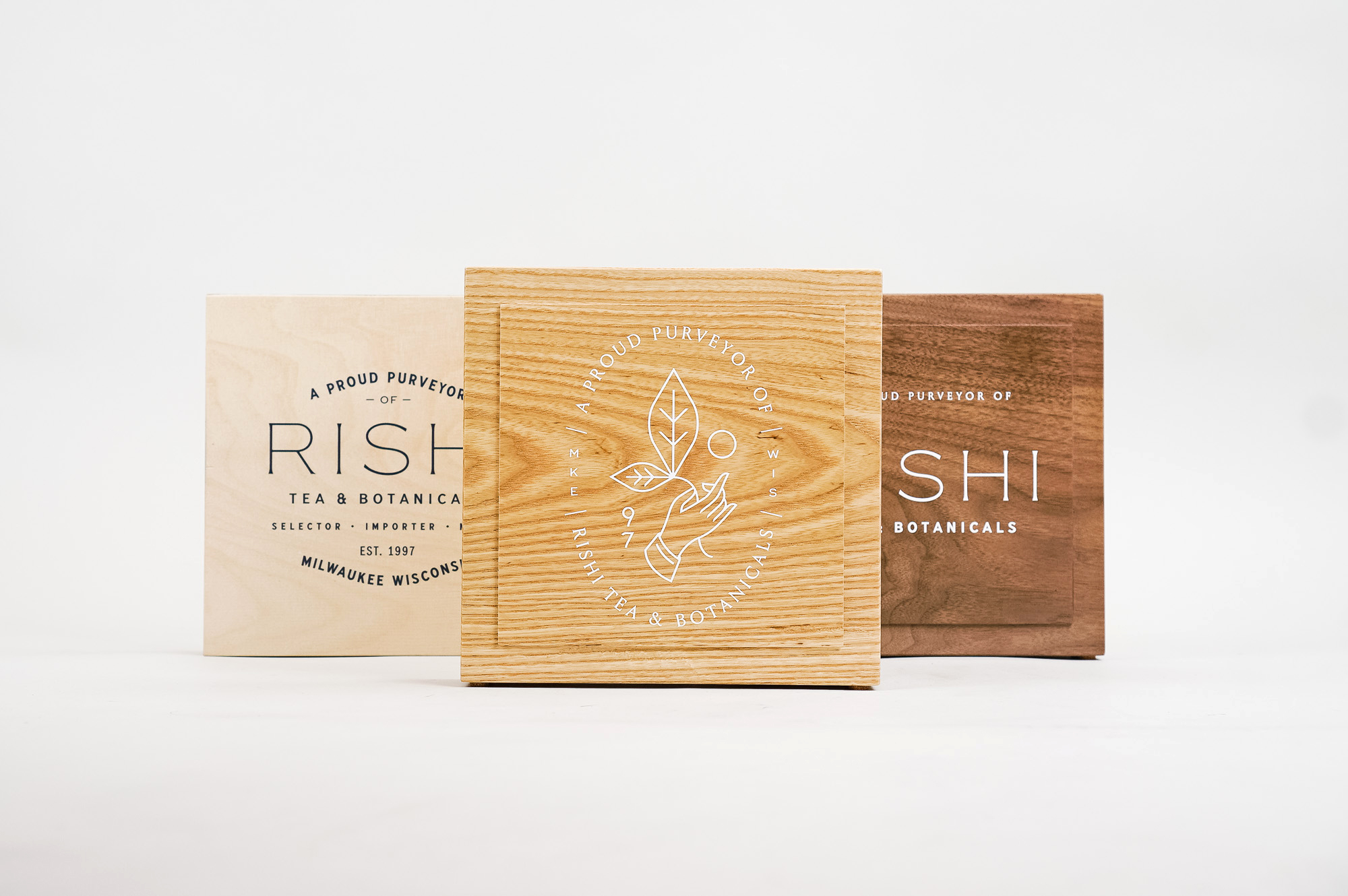Solid wood retail/cafe sign with white artwork for RIshi, a Direct Trade importer of organic teas and botanicals from the very best sources.