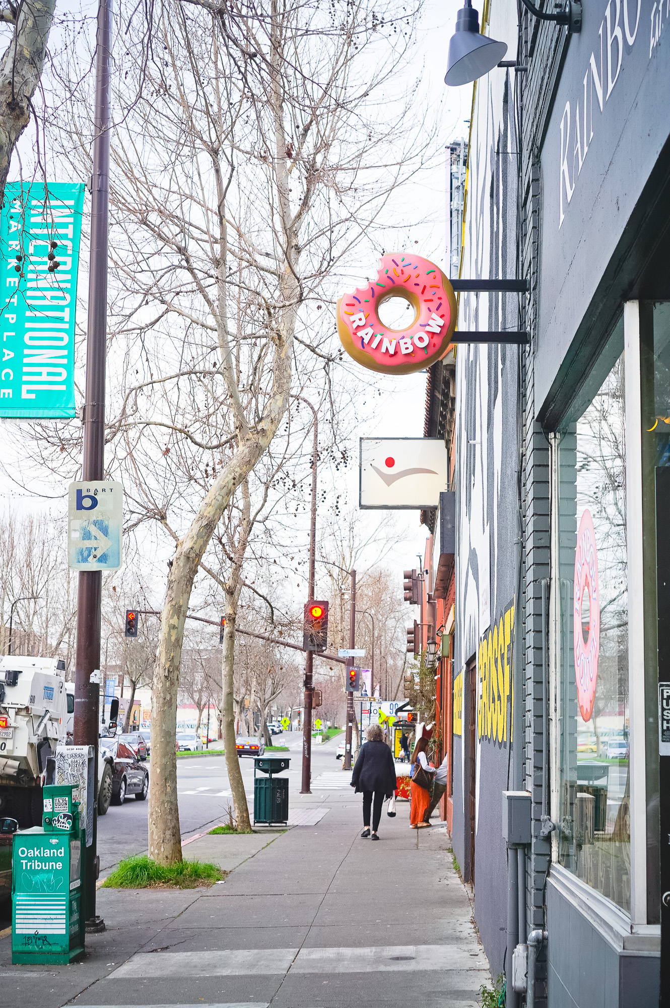 3D, pink-frosted, sculptural, sprinkle donut blade sign for Rainbow Donuts in Berkeley, CA