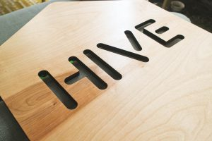 Light wood reverse cut Hive sign for Facebook