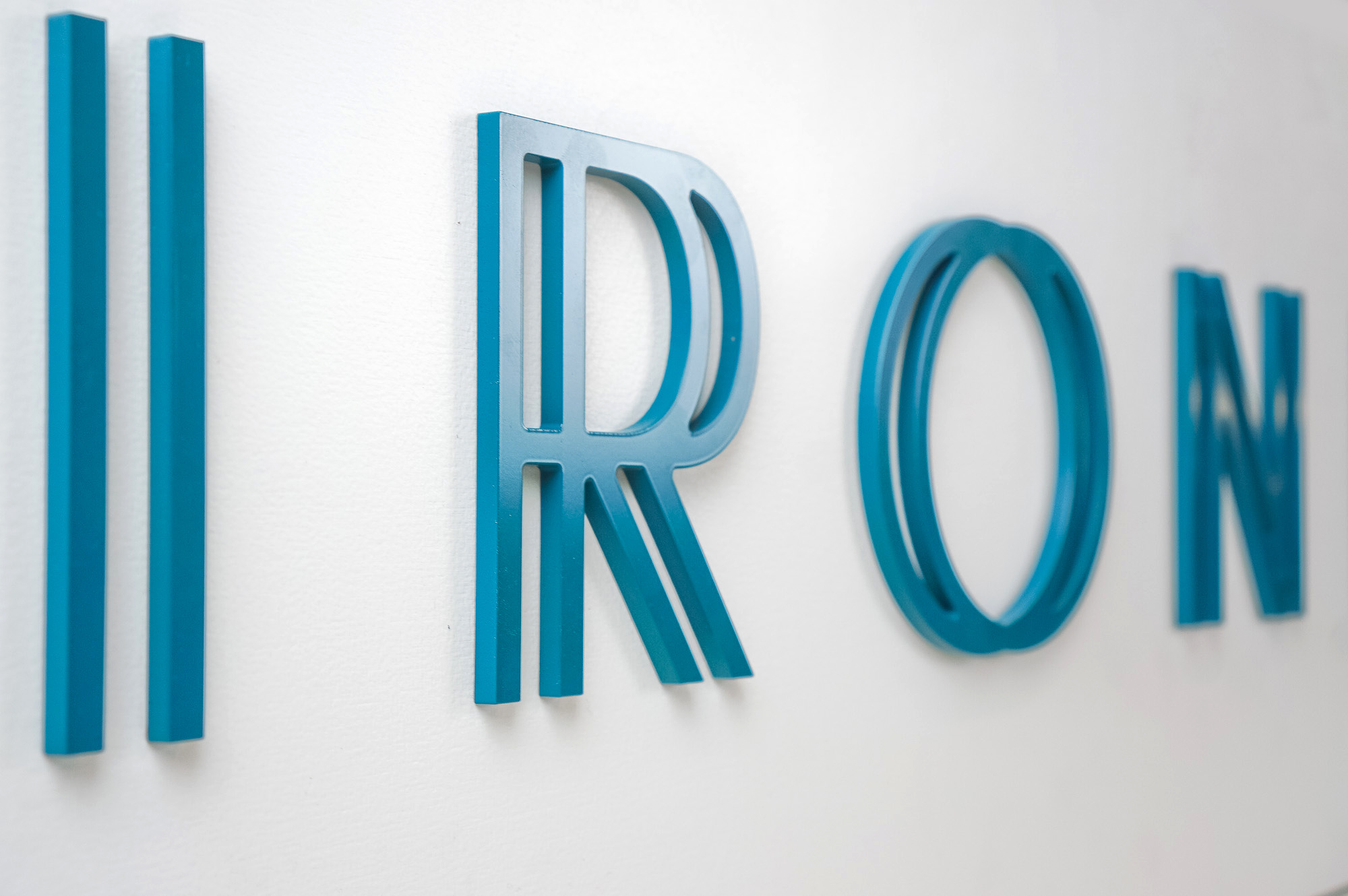 Blue letters on white rectangular panel for 10 Branch, an organization that mentors early stage companies.