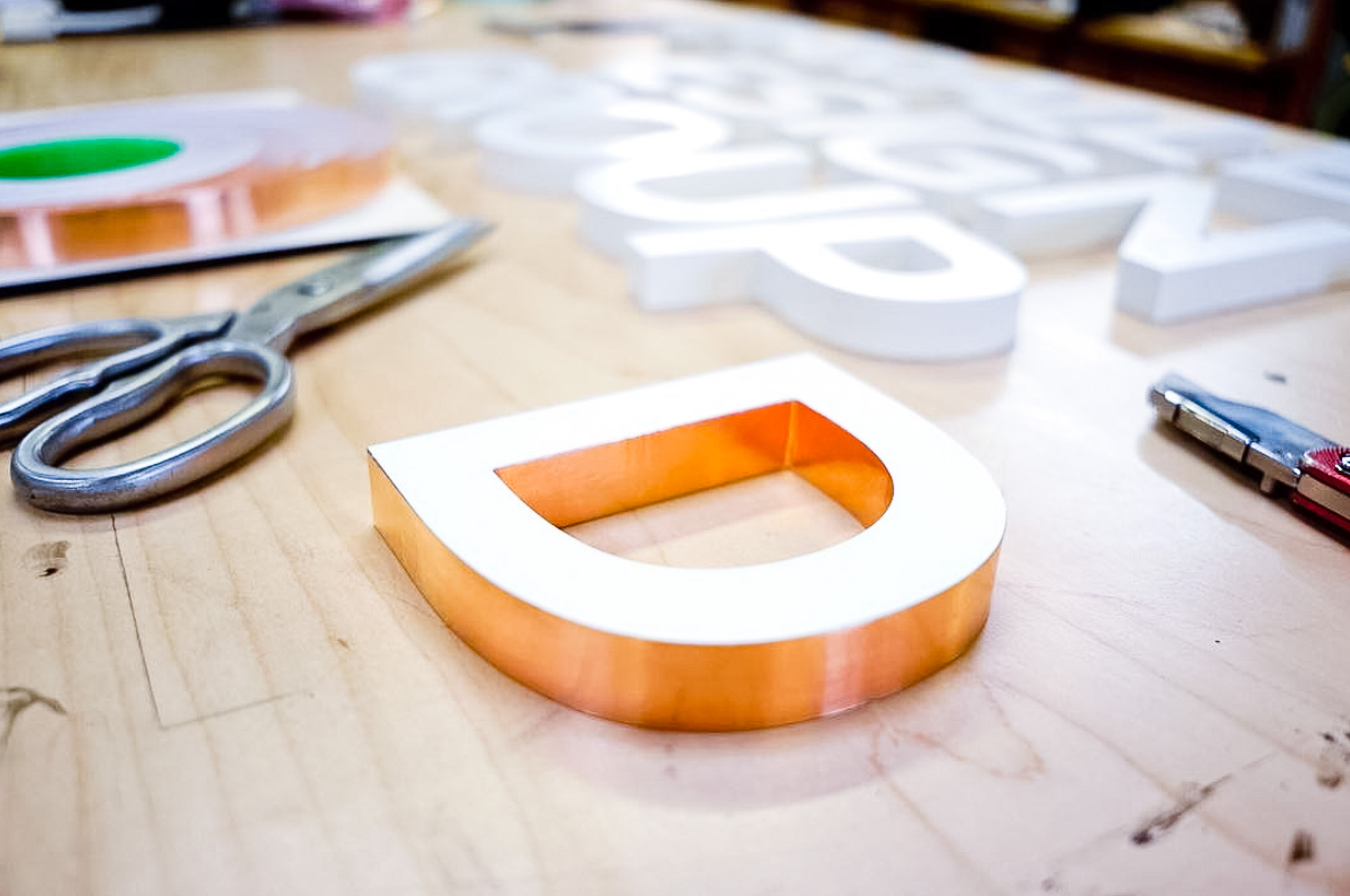 White letters with copper edges for Parallel Design Group, a commercial interior design firm based in Indianapolis, IN.