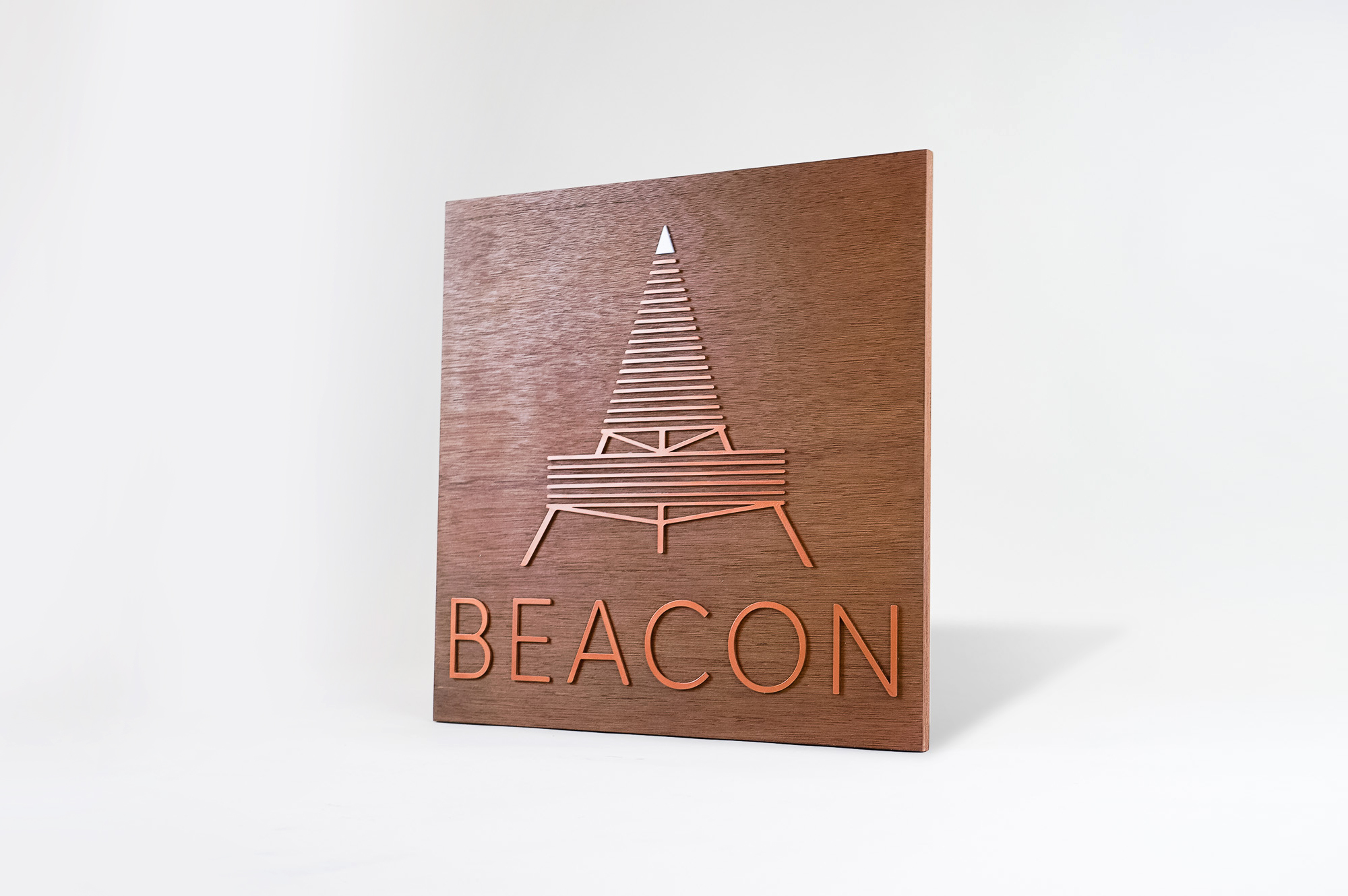 Metallic copper painted acrylic and dark wood outdoor sign for Beacon