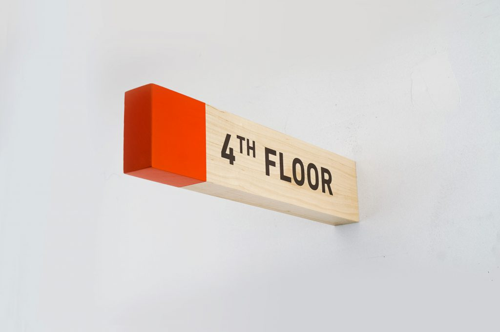 Overhead wood wayfinding signs for Biolite, a New York City based startup that develops and manufactures off-grid energy products for both the outdoor recreational industry and emerging markets.
