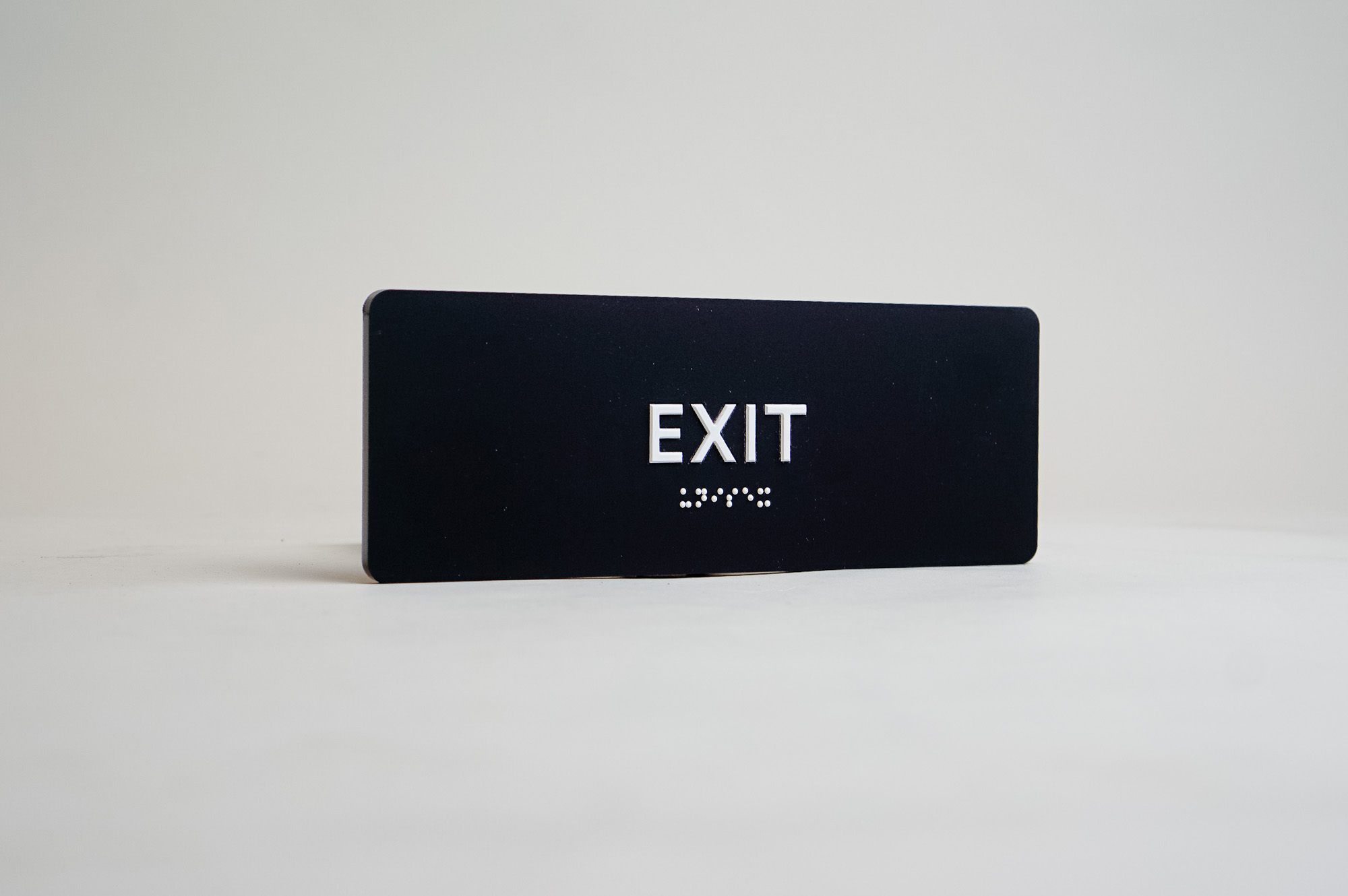 Modern black and white ADA exit sign
