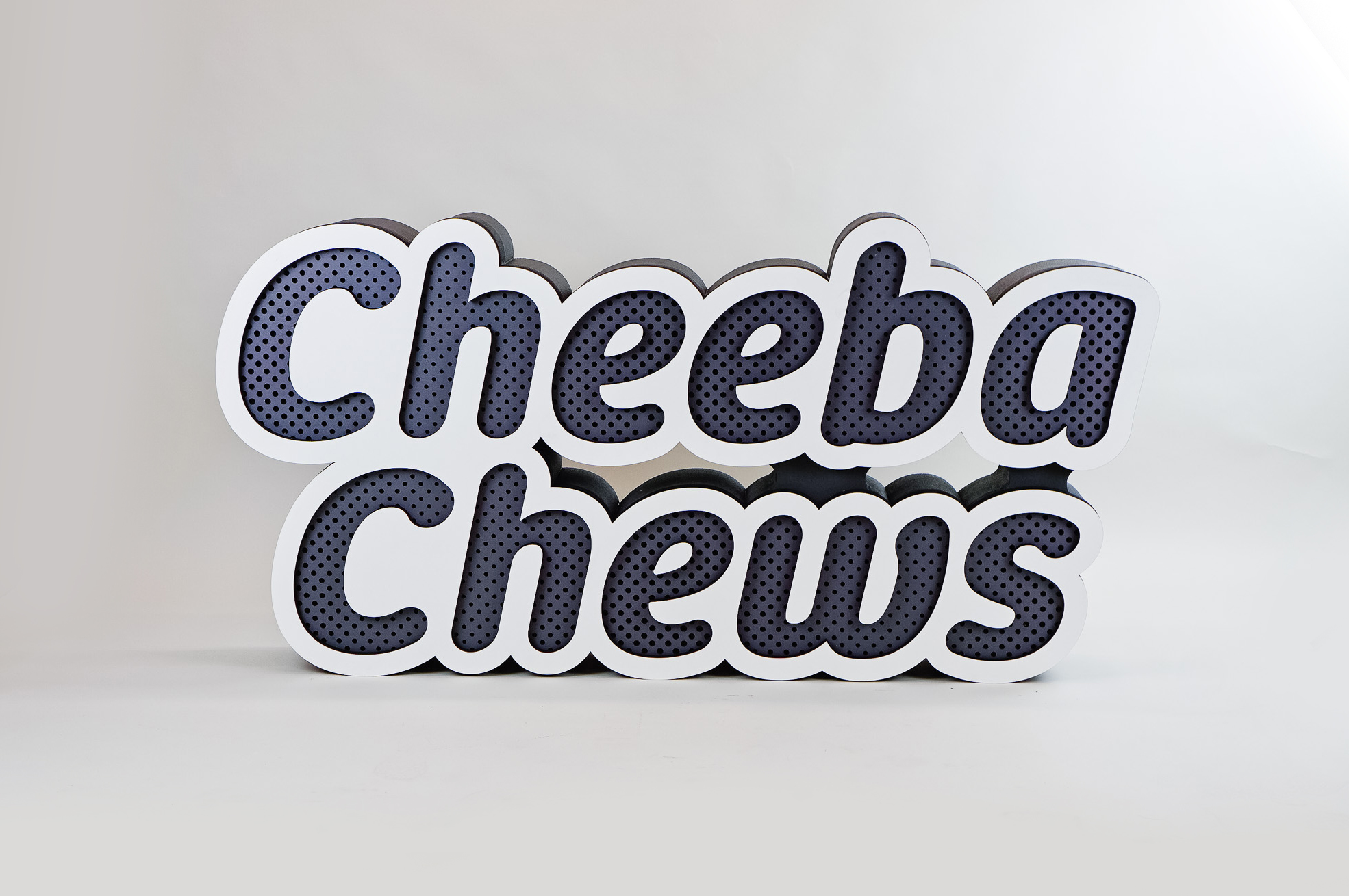 Dimensional large grey and white freestanding tradeshow floor sign for Cheeba Chews, makers of cannabis-infused edibles.