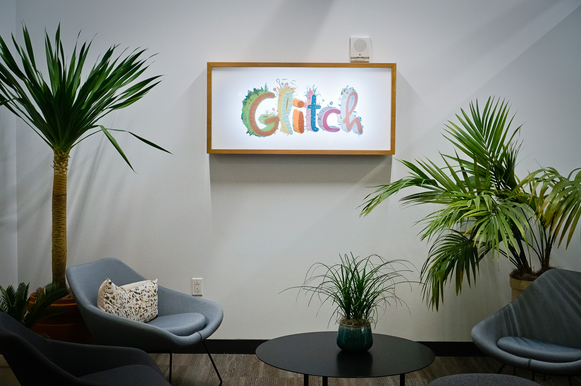 Backprinted full color lightbox sign with wood frame for Glitch, a browser-based, massively multiplayer online game—eventually becoming Slack.