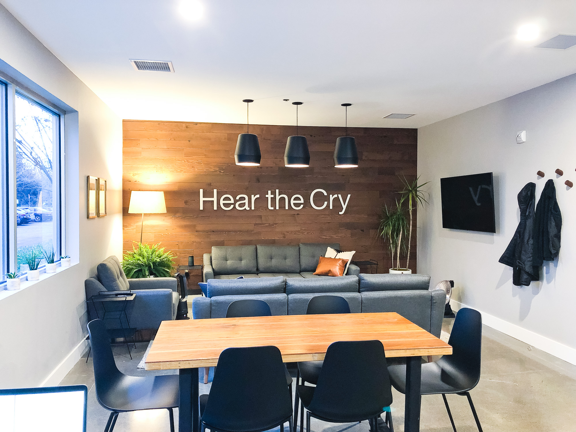 White letters for reclaimed wood wall for Hear The Cry, an organization bringing hope and a future to women and children through grass roots efforts in areas of need.