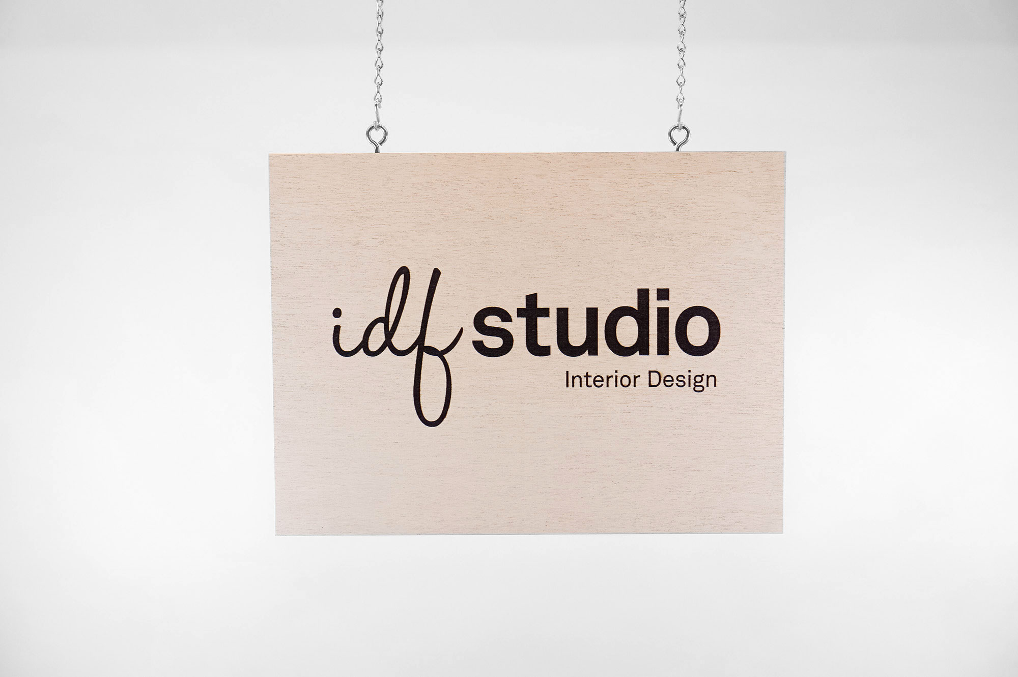 Etched weather resistant wood sign for IDF Studio, an interior design agency based in San Francisco.