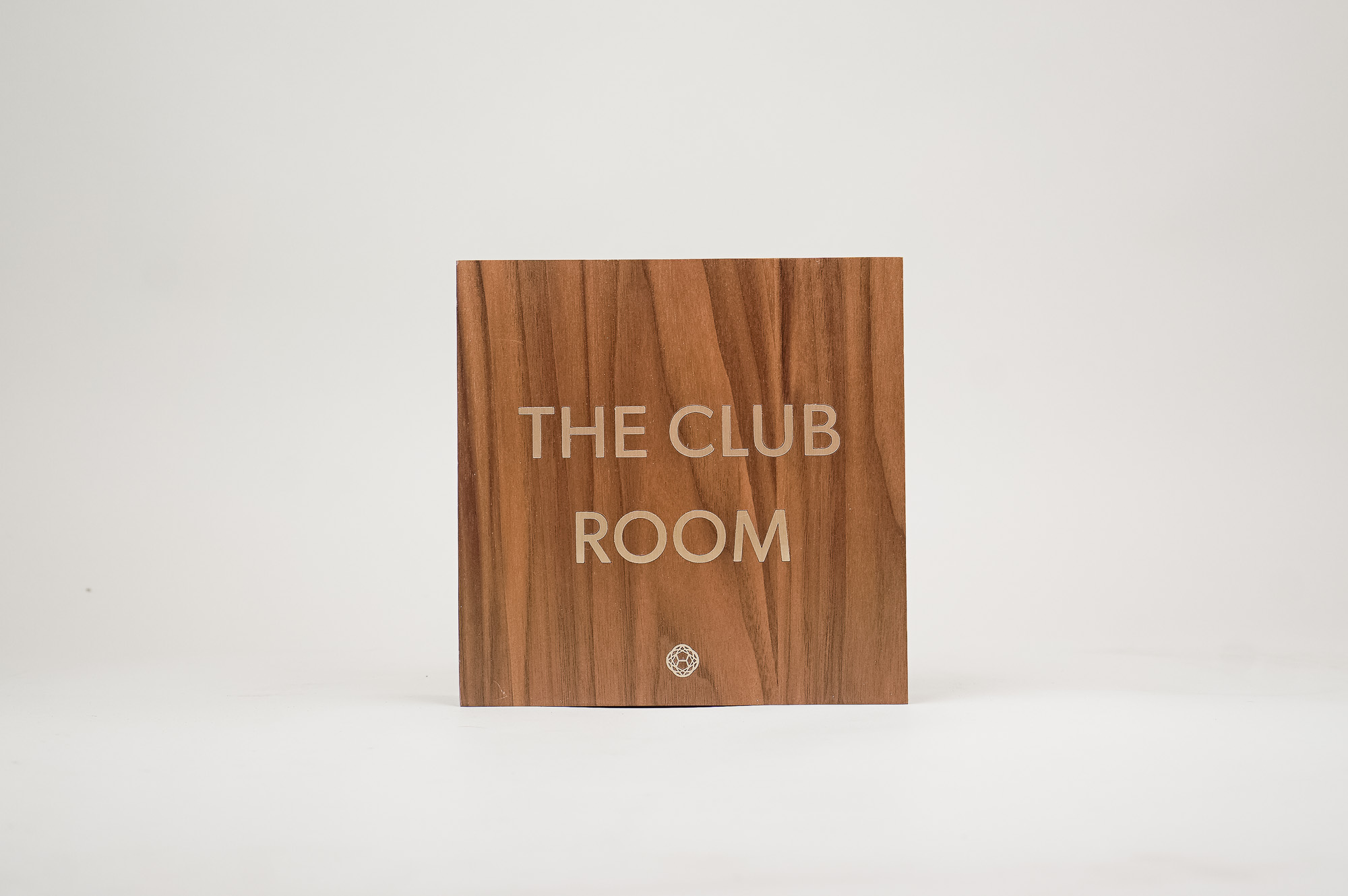Vintage walnut and inlaid-brass style sign for Nexus Club, a private social and business club in New York.