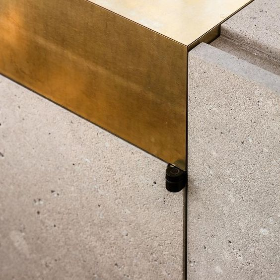 brass and concrete