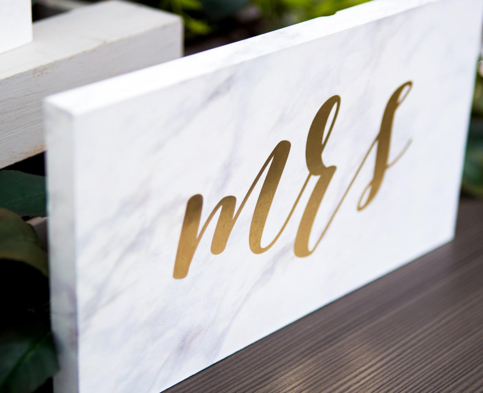 gold script on marble sign