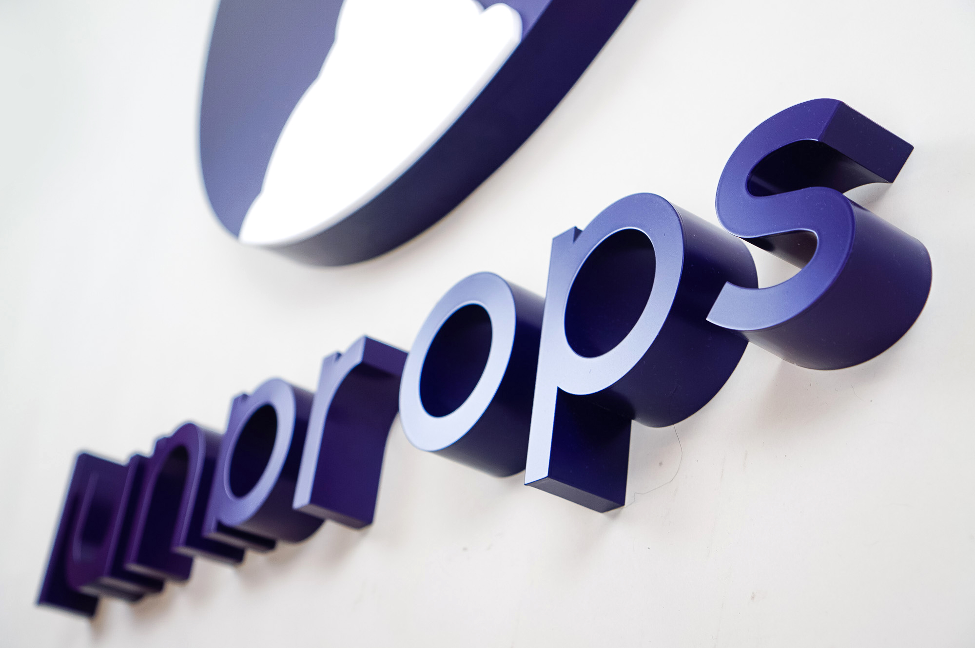 Dimensional purple letters and white rocket ship for Lunar Ops, Inc. in New York.