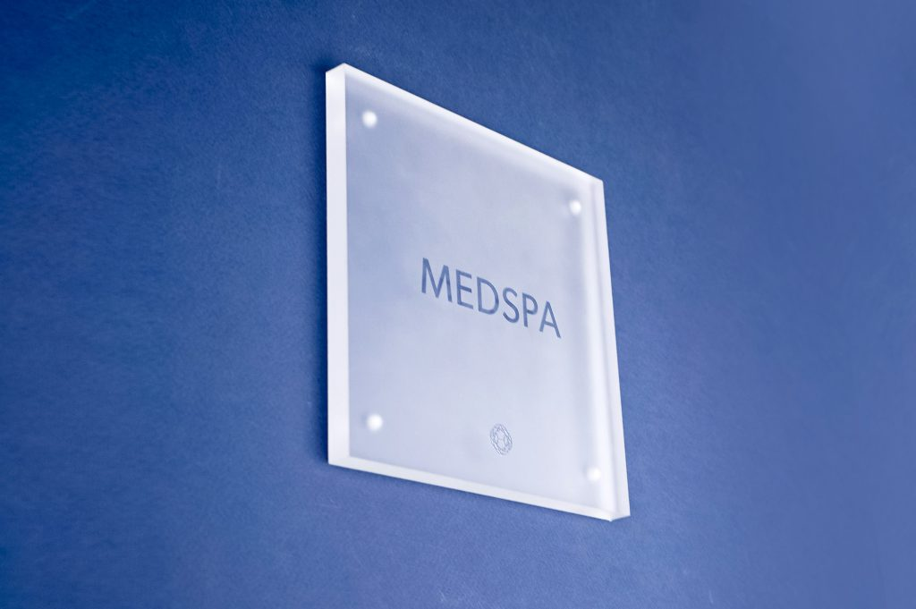 Frosted room sign with glossy clear ink for Nexus Club, Nexus Club, a private social and business club in New York.