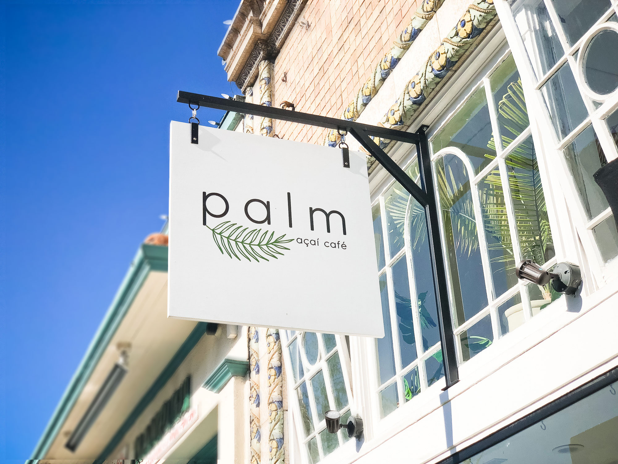 Simple white blade sign for palm acai cafe in Oakland, CA
