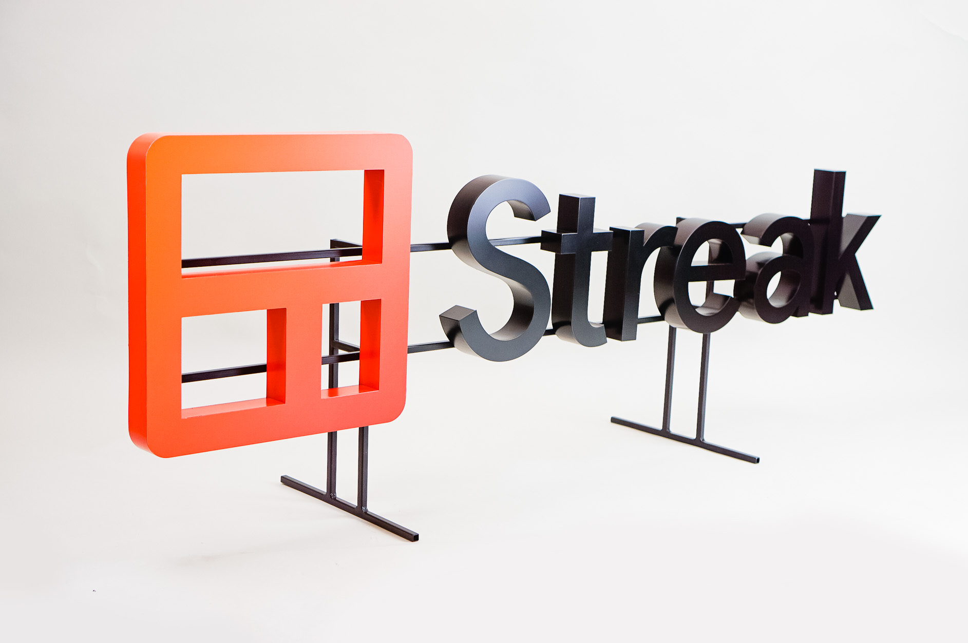 Freestanding cutout logo on a shelf at the entrance of Streak, a San Francisco based relationship management platform for Gmail.
