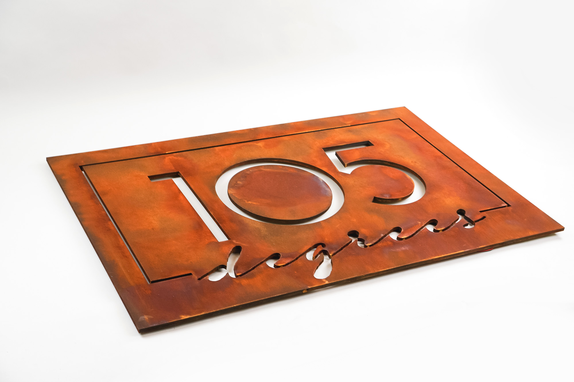 Rusted metal illuminated sign for 105 Degrees, a hot yoga studio at Newtown Athletic Club, a premiere family fitness and wellness center serving residents of Newtown, PA