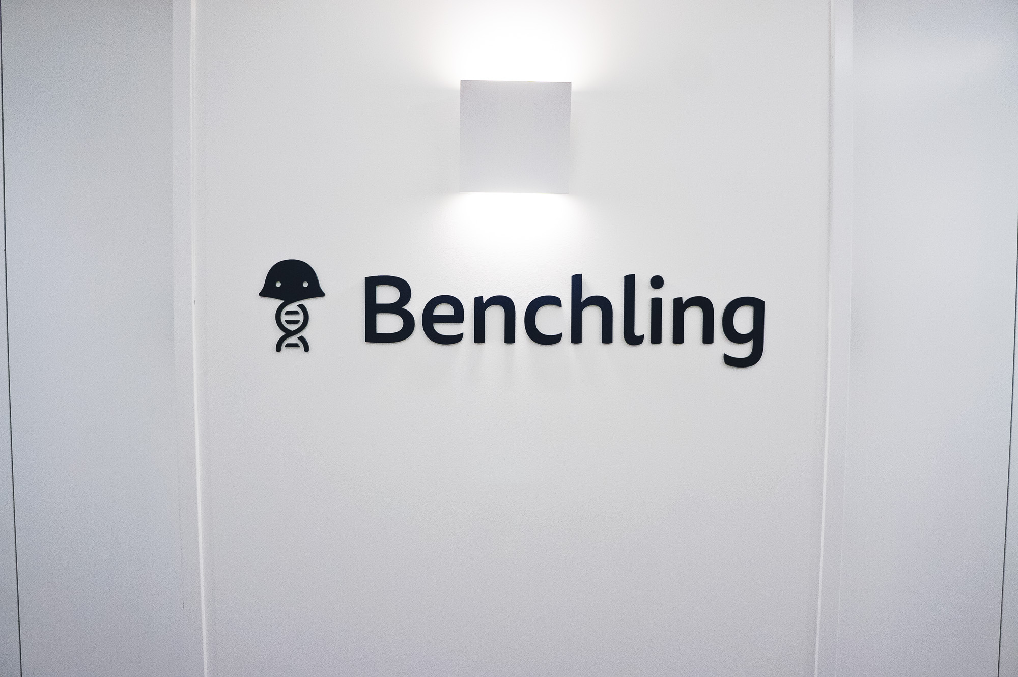 Navy blue elevator vestibule sign for Benchling, a San Francisco based company working on a unified platform to accelerate, measure, and forecast R&D from discovery through bioprocessing.