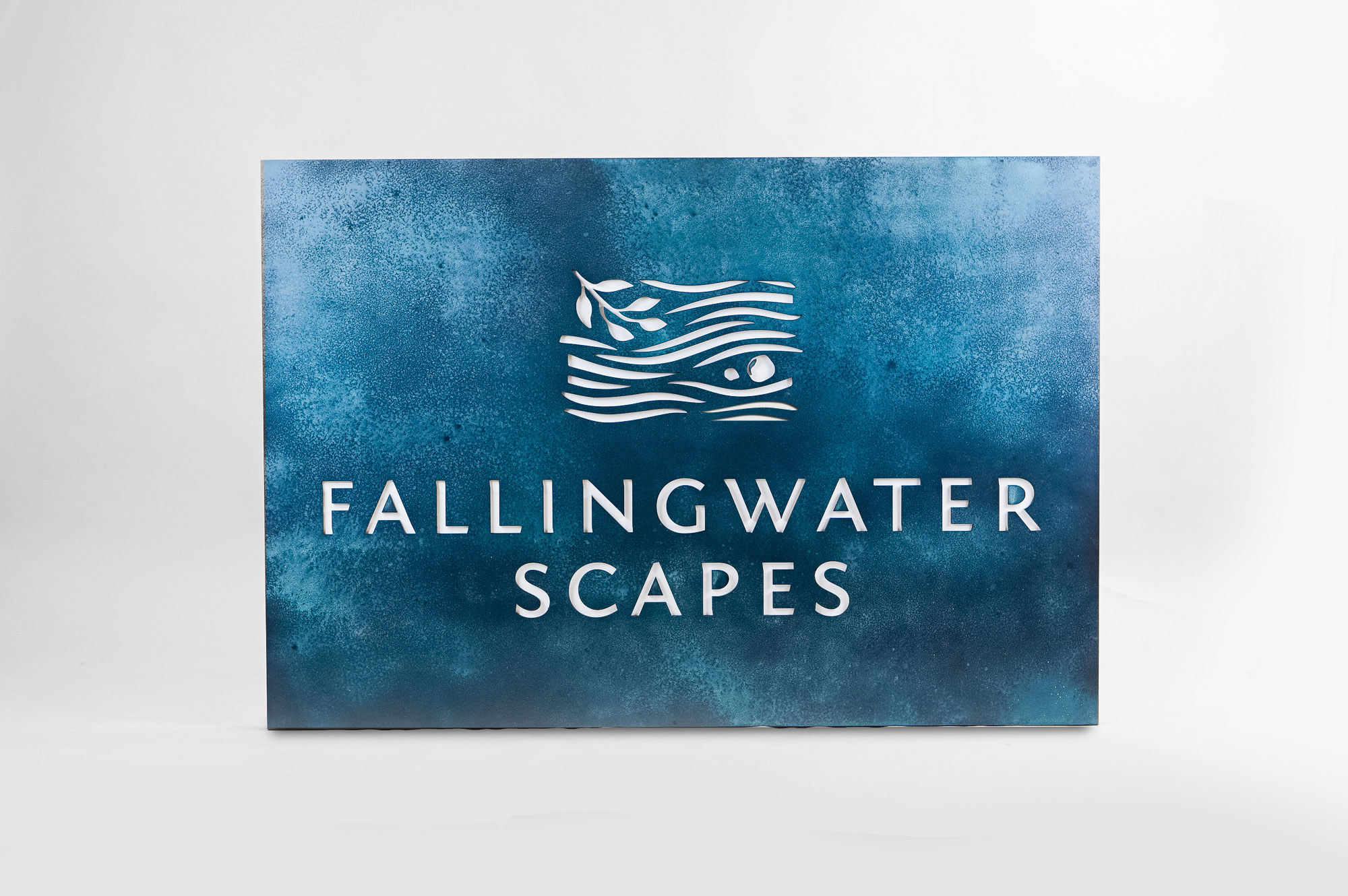 Blue-hued, rusted bronze/brass/copper patina style sign for FallingWater Scapes, a water feature design, construction and maintenance company in Dover, MA.