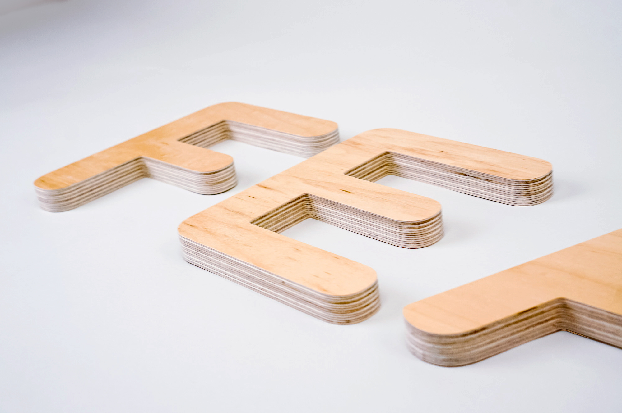 CNC routed plywood letters for Feather, furniture renting service.