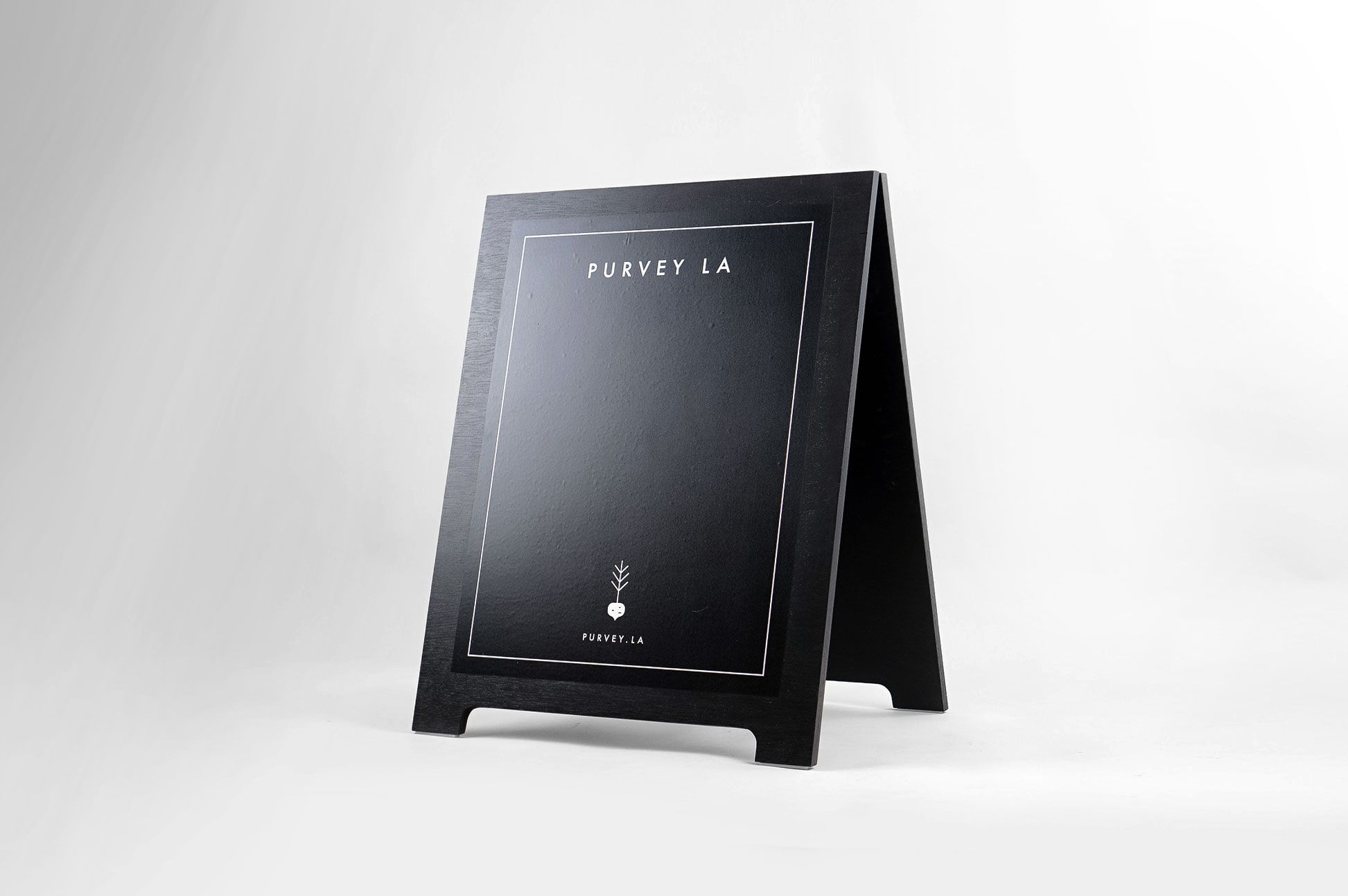 All black modern chalkboard sidewalk/farmer's market a-frame sign for Purvey, a Los Angeles based business delivering ready-to-eat, family-style meals to offices and families.