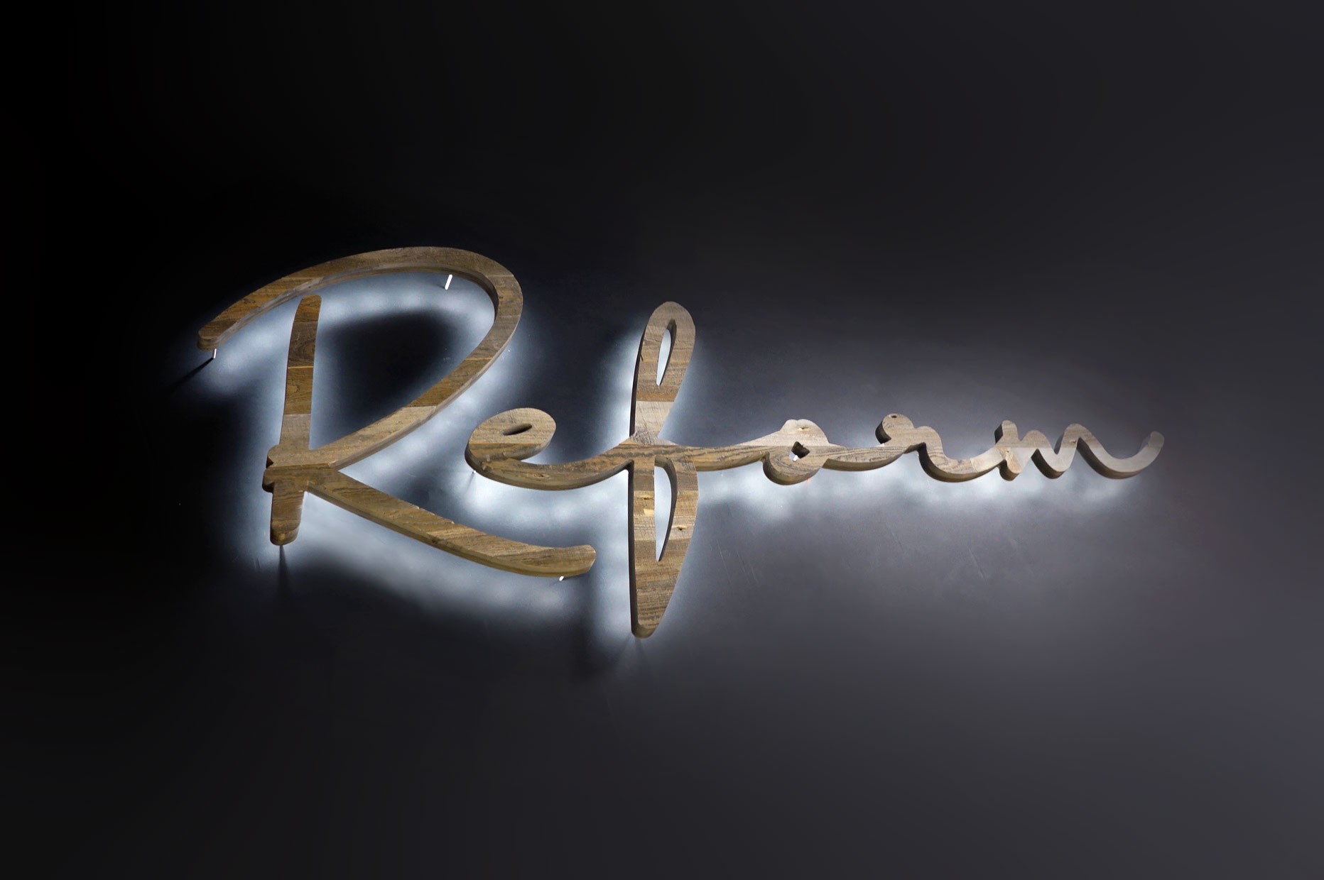 Reclaimed wood illuminated script sign for Reform, a fitness studio at Newtown Athletic Club, a premiere family fitness and wellness center serving residents of Newtown, PA