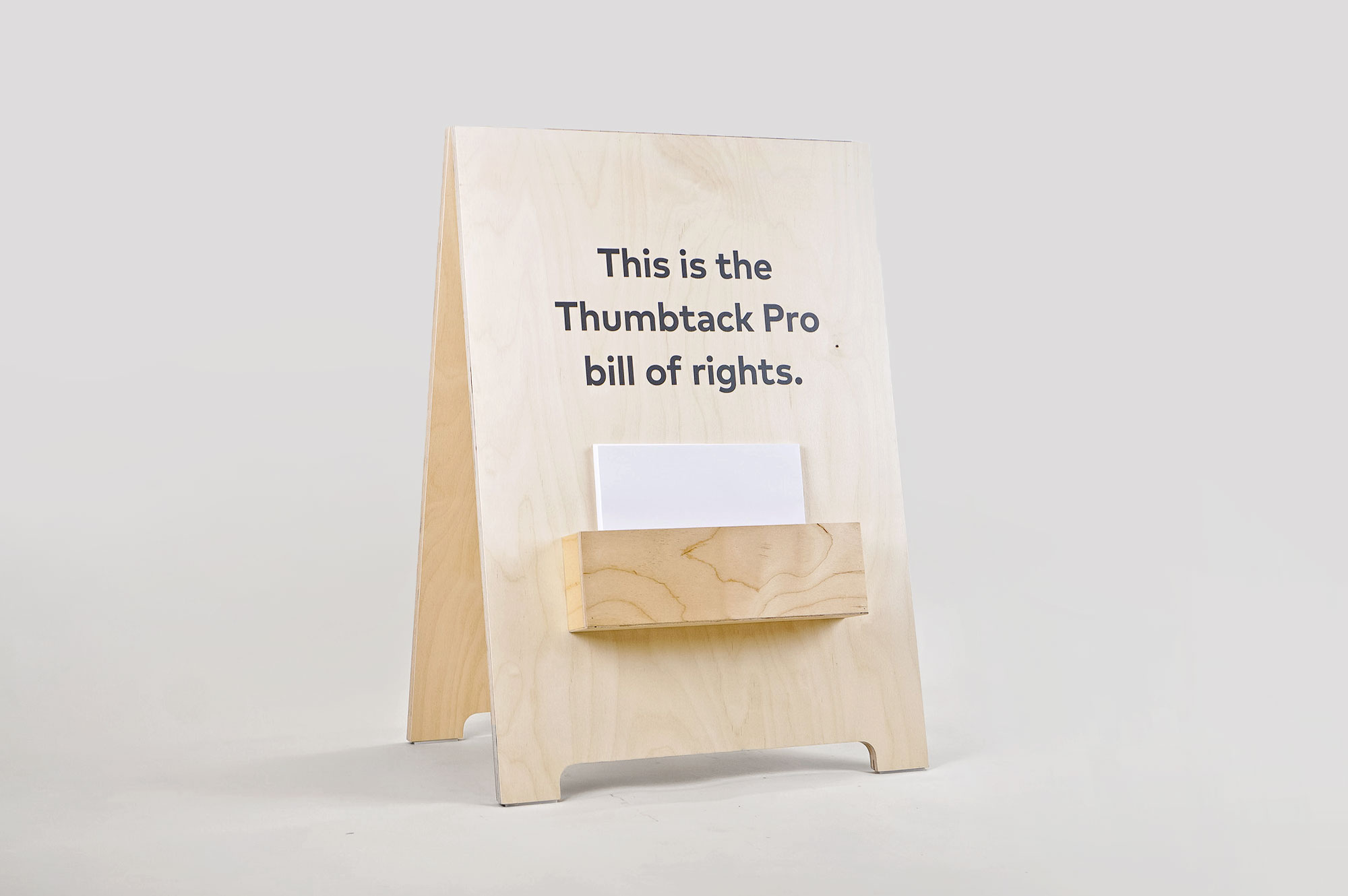 Light wood a-frame with brochure pocket for Thumbtack, an online service that matches customers with local professionals.