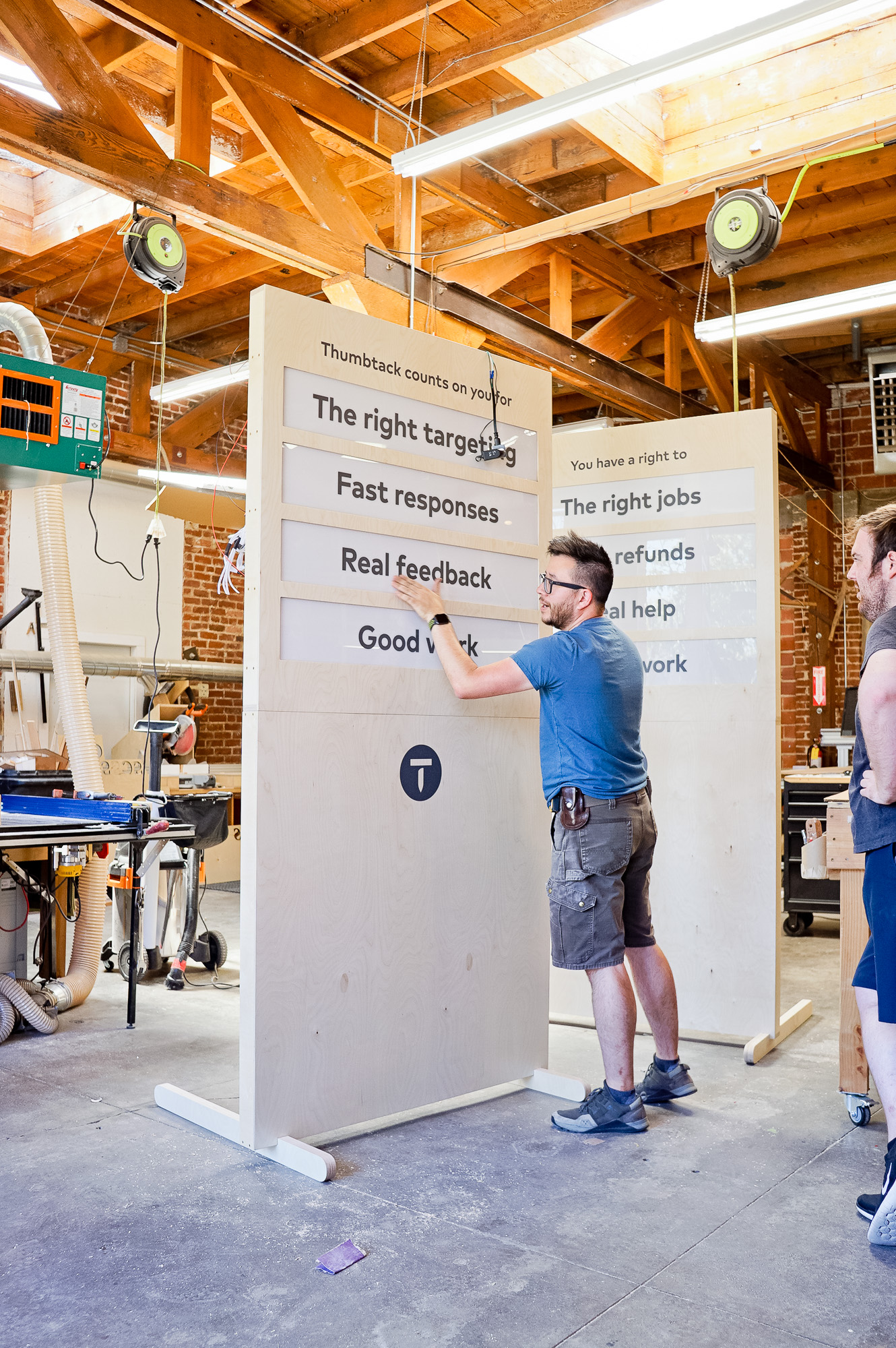 Illuminated, light wood freestanding panel sign for Thumbtack's special events around the country.