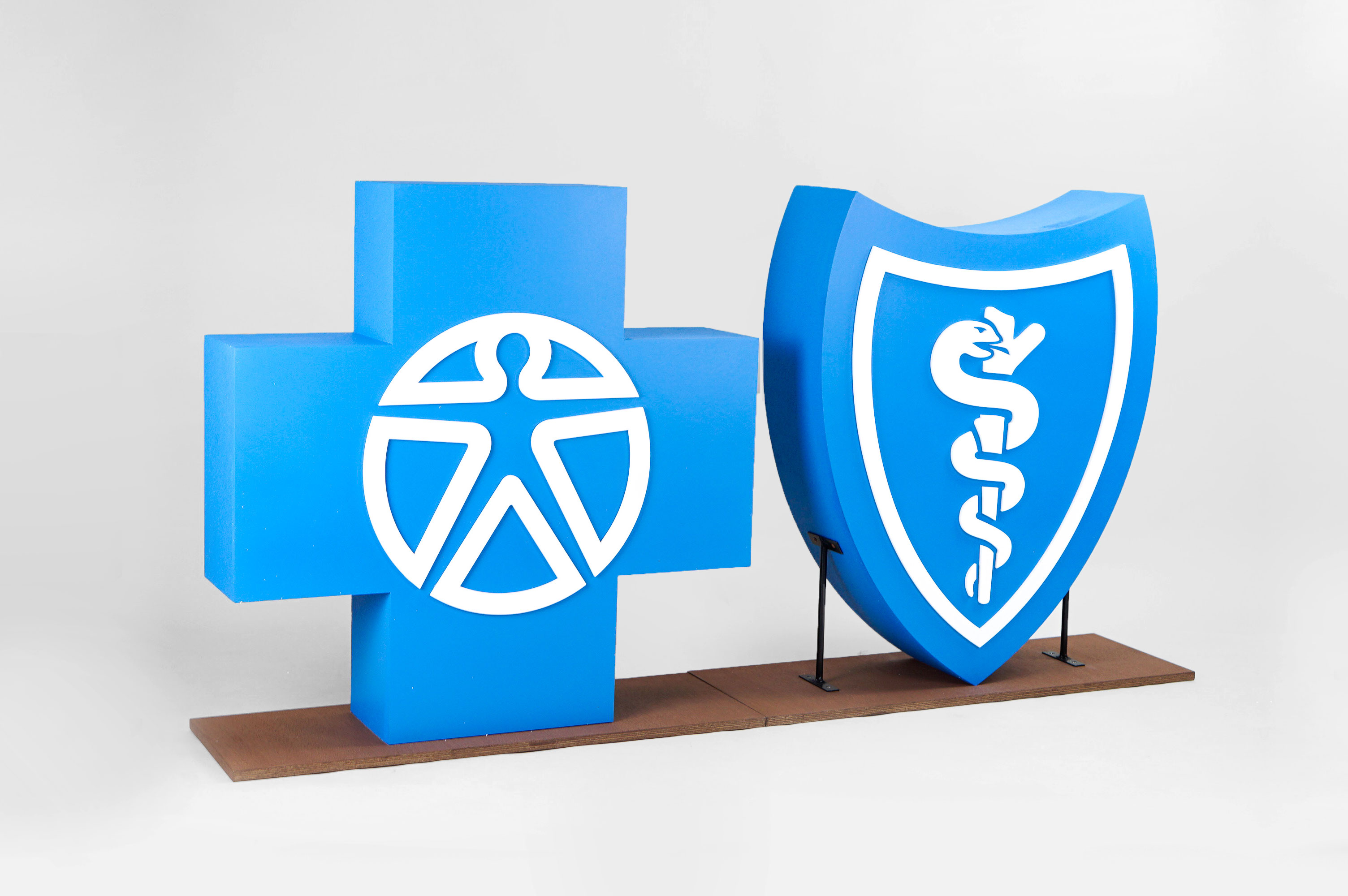 Large scale blue and white Blue Cross Blue Shield foam freestanding event logos for Aspen Event Works, a boutique event planning company specializing in creative and memorable event experiences.