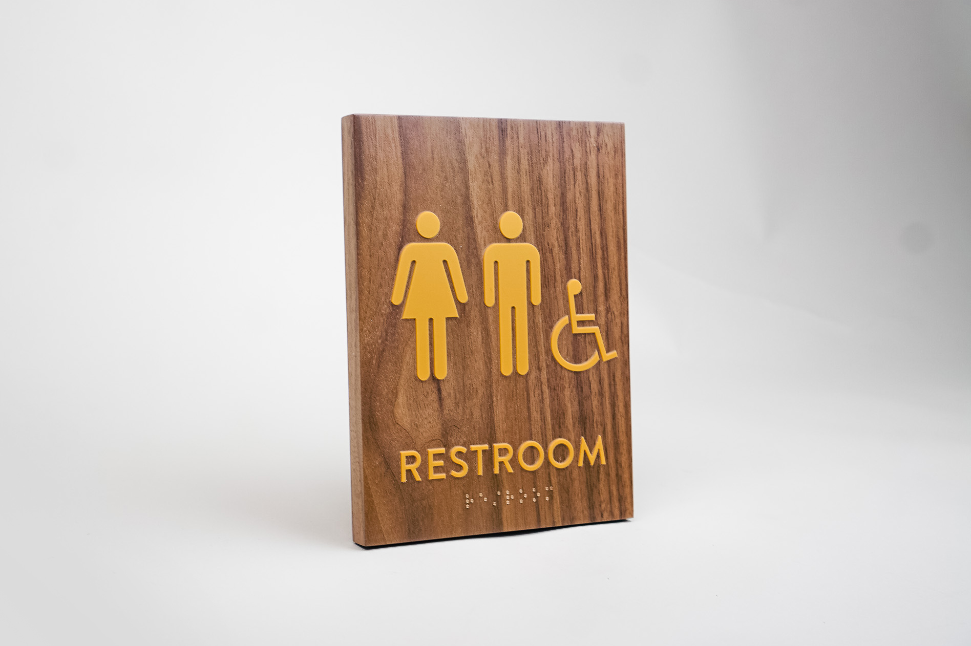 Gold and walnut wood ADA compliant restroom sign