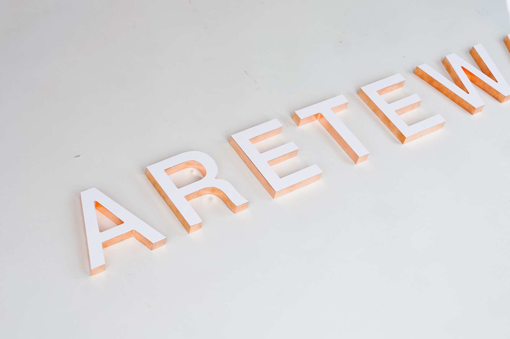 White letters with copper edges for Areteway, a clothing and gift boutique in Santa Rosa, CA.