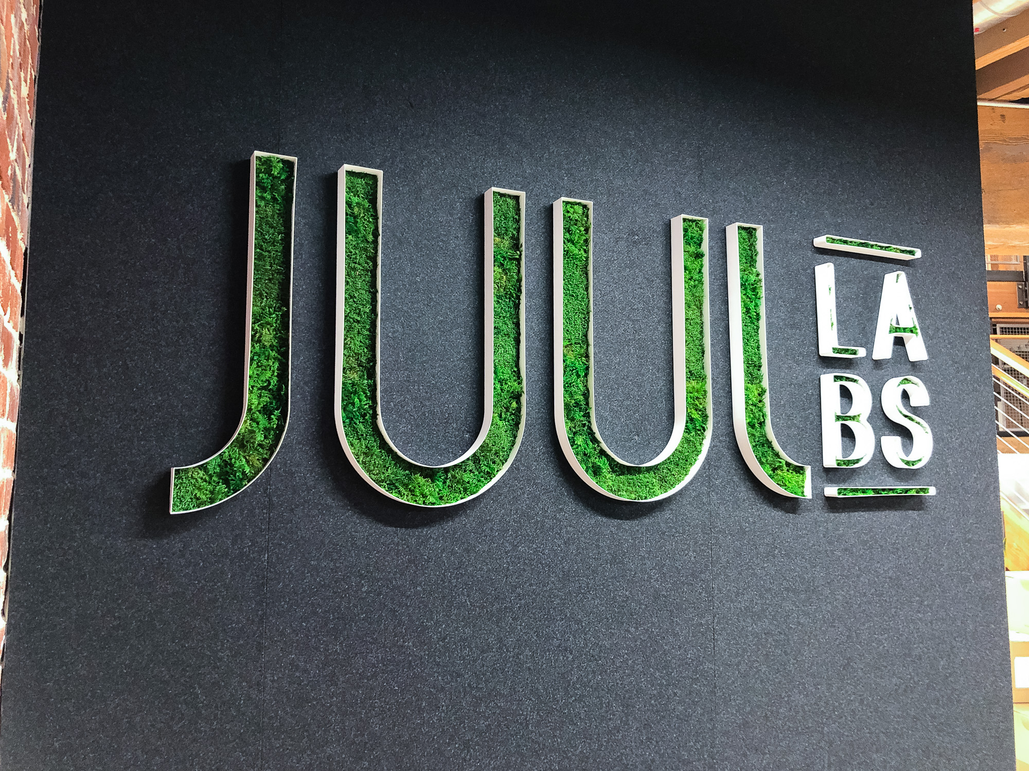 Moss filled lobby sign for the San Francisco office of Juul, an electronic cigarette company.