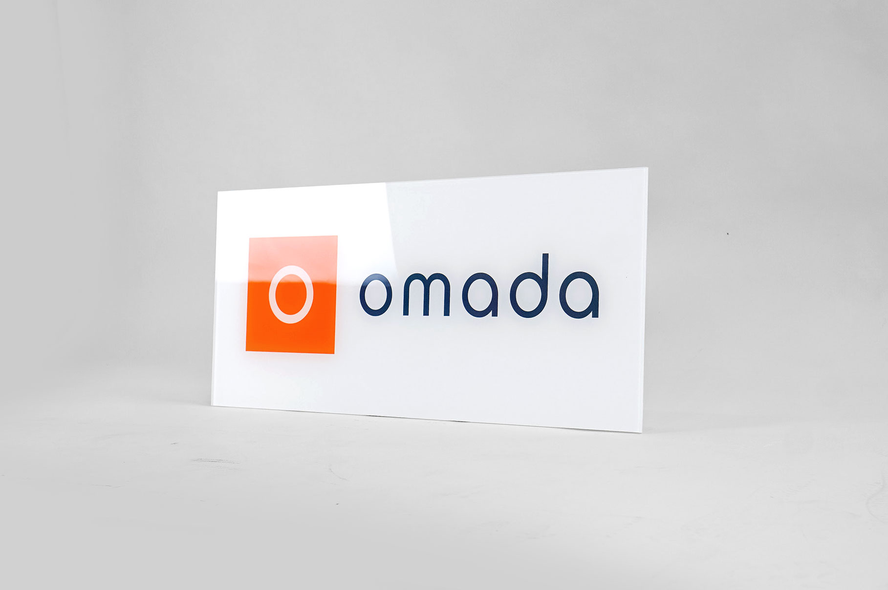 Glass-like, printed panel sign for Omada Health, a San Francisco based company pioneering digital behavioral medicine.