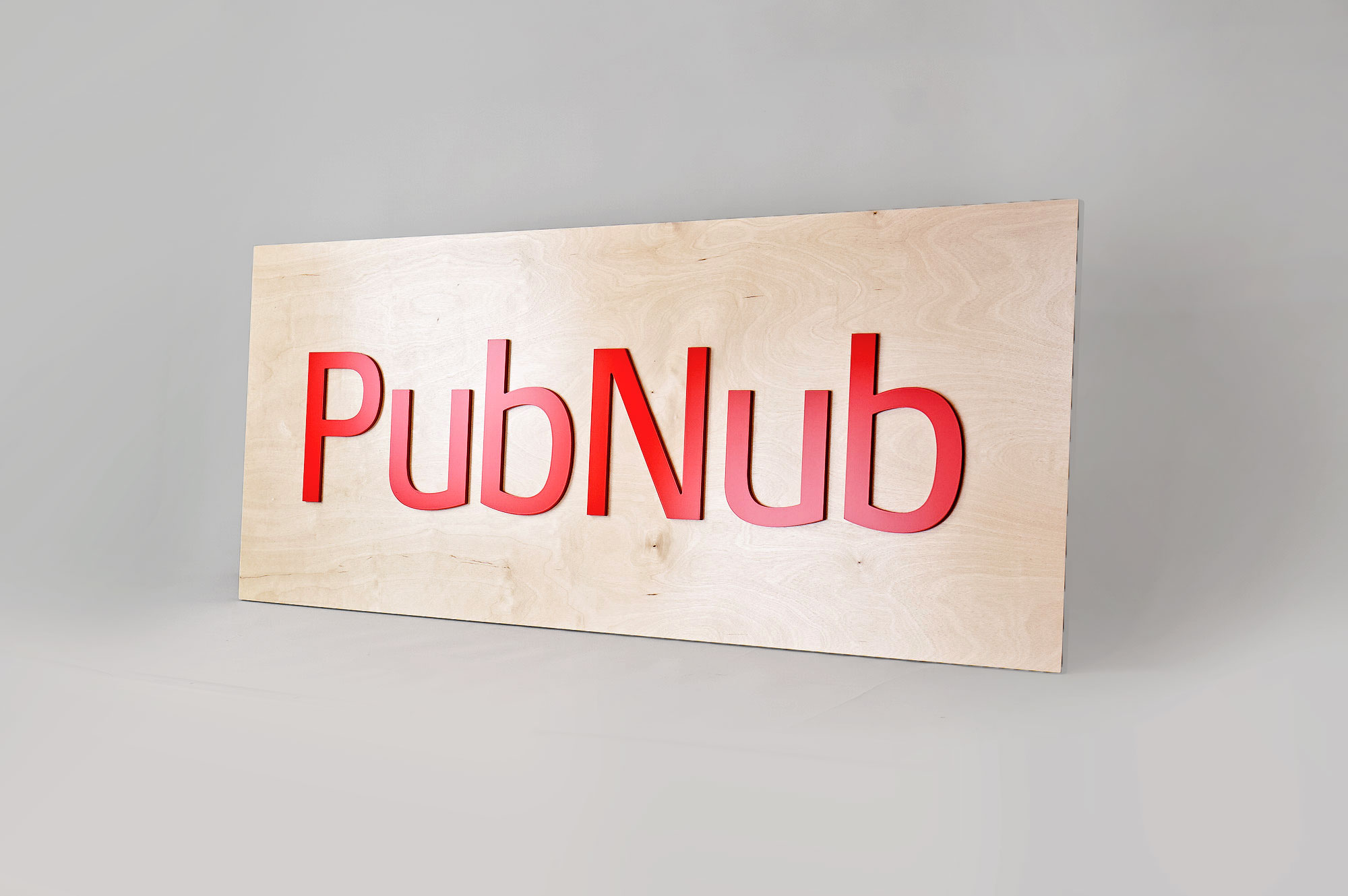 Light wood sign with red letters for PubNub, a global Data Stream Network and realtime infrastructure-as-a-service company based in San Francisco, California.