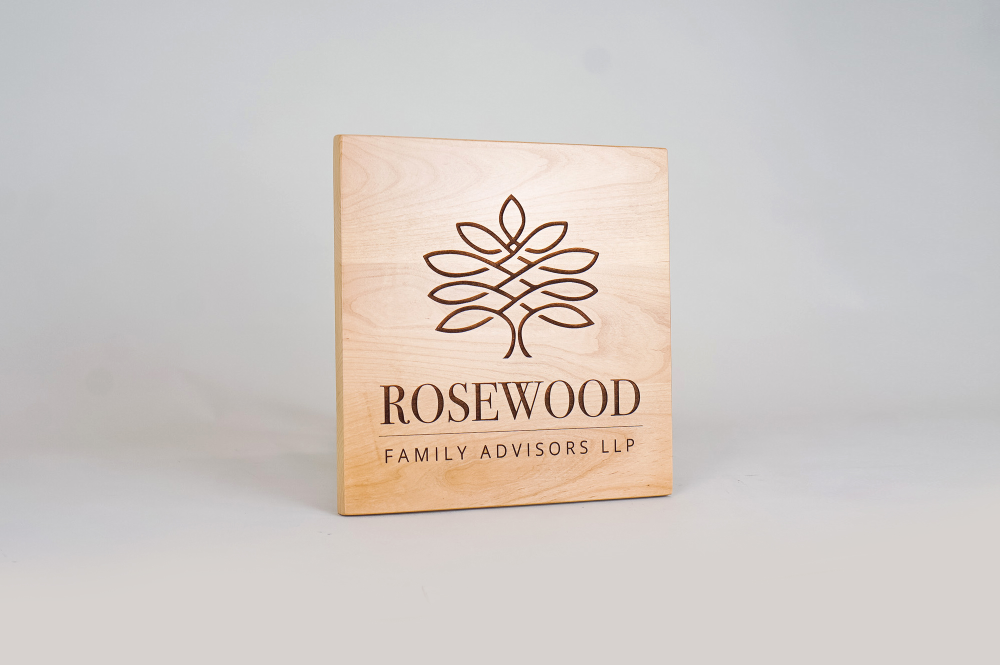 Etched light wood sign for Rosewood Family Advisors, a Palo Alto based company offering a diverse range of family office services.