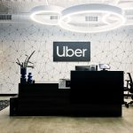 Black and white lobby sign for Uber, an American multinational transportation network company.