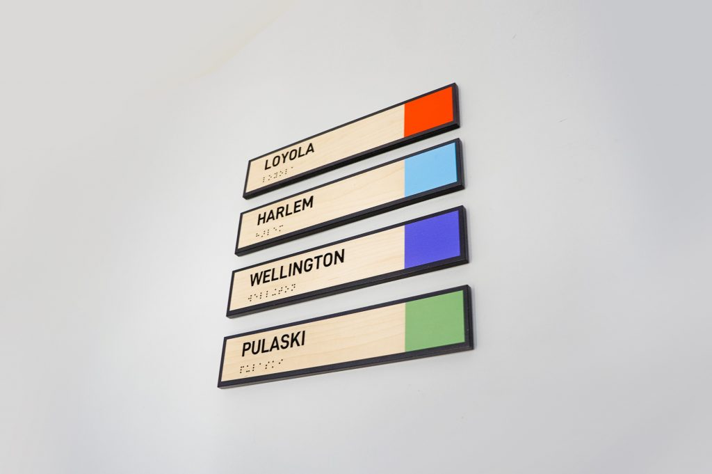 Light wood, color-coded phone booth signs for G2, a company that compares business software and services based on user ratings.