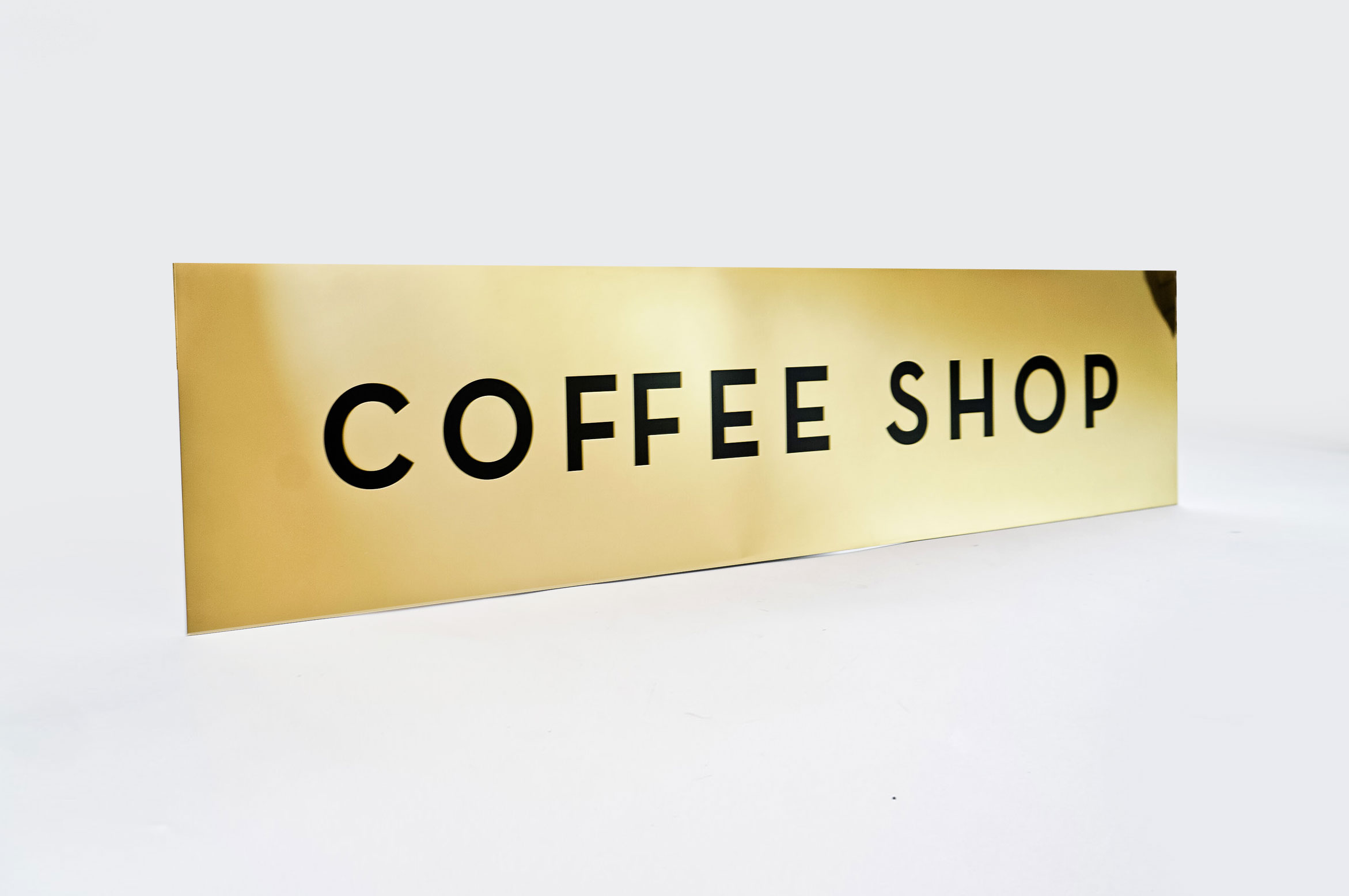 Classic style, solid brass coffee shop sign for Mickey's Fine Pharmacy, a Beverly Hills landmark.