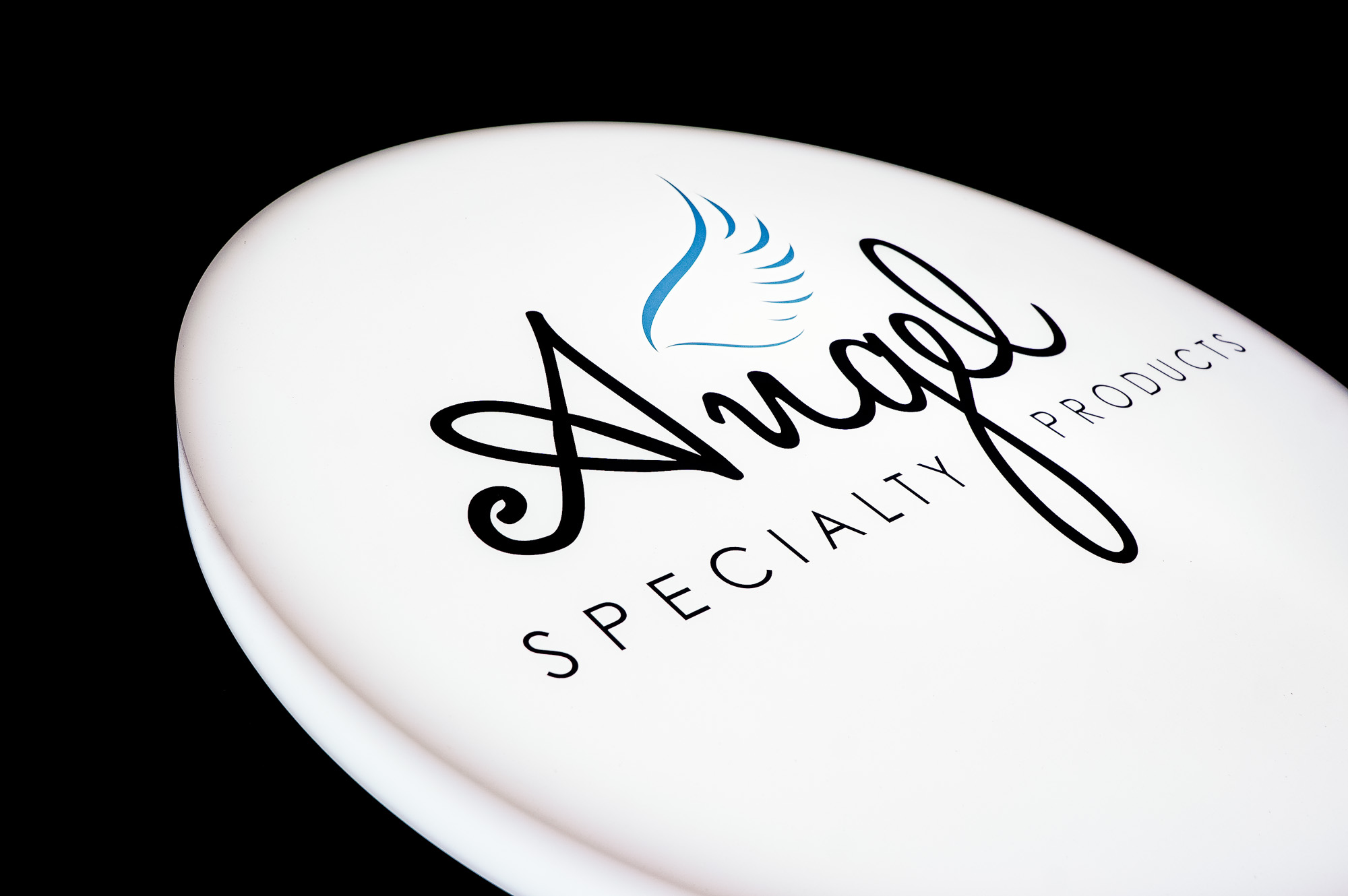 Illuminated, circular, face-lit sign for Angel Specialty Products