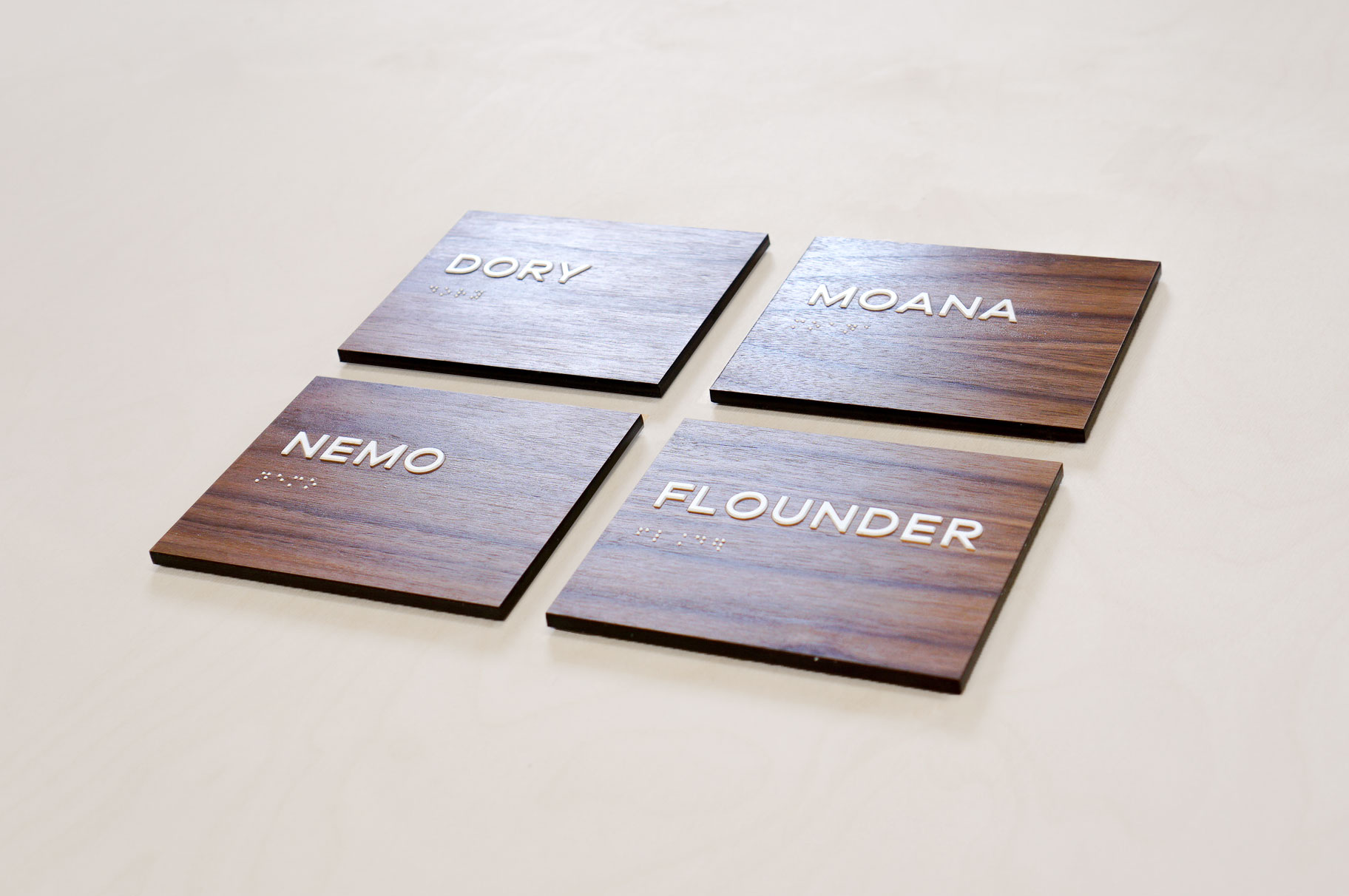 Luxe walnut wood ADA meeting/conference room signs for the office of Aquatic, a research and development company based in Chicago, IL.