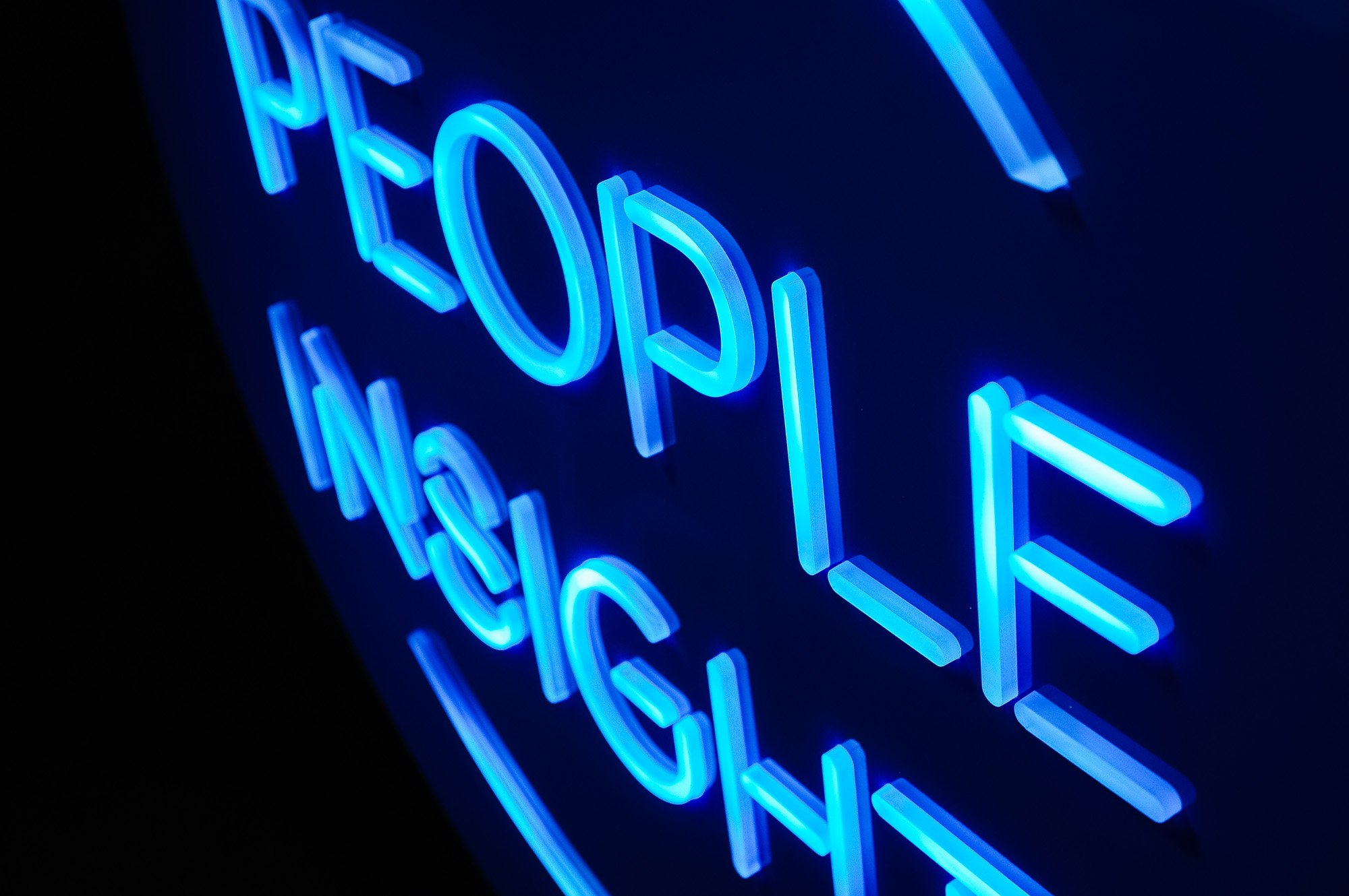 Blue neon-style team sign for Facebook, an American online social media and social networking service company.